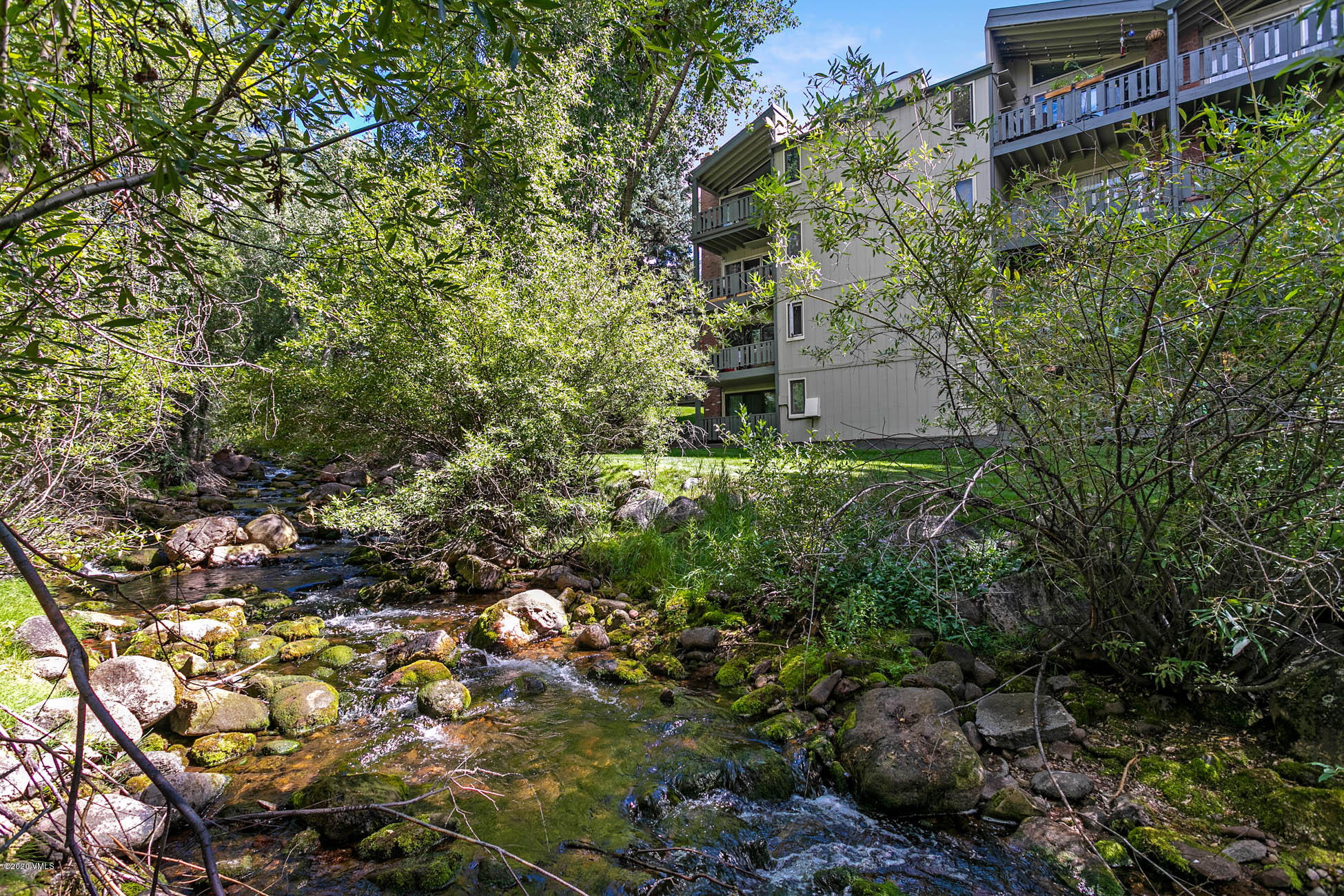 Walk to Lionshead from this beautiful 2 bedroom/2 bath overlooking Sandstone Creek!  Impeccably maintained and offered furnished!  End unit with lots of windows and light!  Sleep to the sounds of the creek!