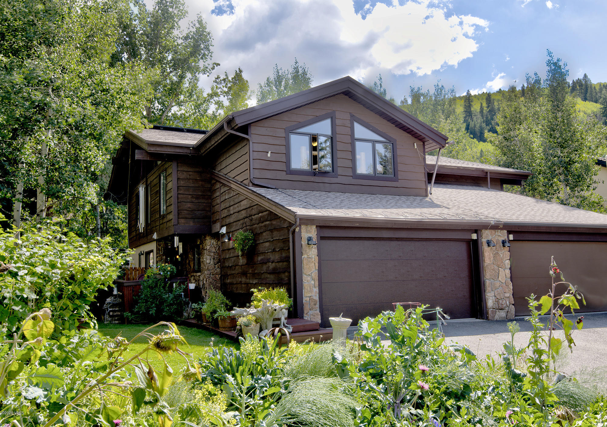 A fabulous location in Eagle-Vail. A quiet neighborhood with a very private and fenced back yard with a dog door. Two raised garden beds with a drip system. Functional kitchen with NEW refrigerator and dishwasher. Gas stove, gas fireplace and gas line outside for grill. Walk-in pantry off of kitchen. Two lofts on upper level. Steam shower in Master bathroom. Washer & Dryer in Primary, large walk-in closet. Brand new garage door. Storage shed out back. Beautiful gardens outside. Must see Duplex and neighborhood! Minutes from Vail and Beaver Creek skiing and outdoor activities and restaurants.
