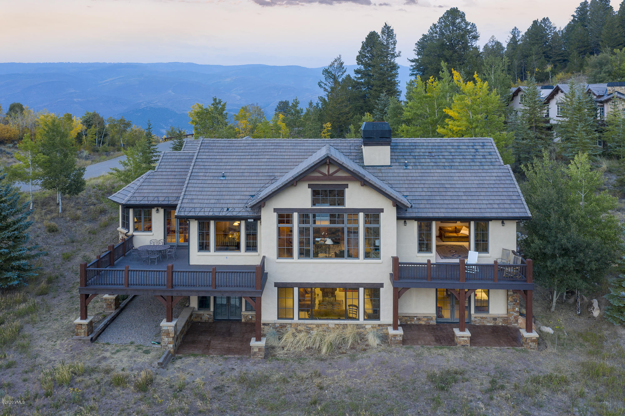 Perfect Cordillera home for those wanting main floor living with a gracious layout including primary bedroom and bath, laundry room, side entry with ski and boot storage, 3-car garage plus sun room/study and breakfast nook.  Granite kitchen with custom cabinetry is a chef's dream.  Dramatic views to the west from every room add to the spacious feel of high ceilings and rustic beaming.  Lower floor for the rest of the group boasts 4 additional bedrooms, 2nd laundry room a wine room and wet bar.  Private setting with numerous outdoor spaces for year round enjoyment.