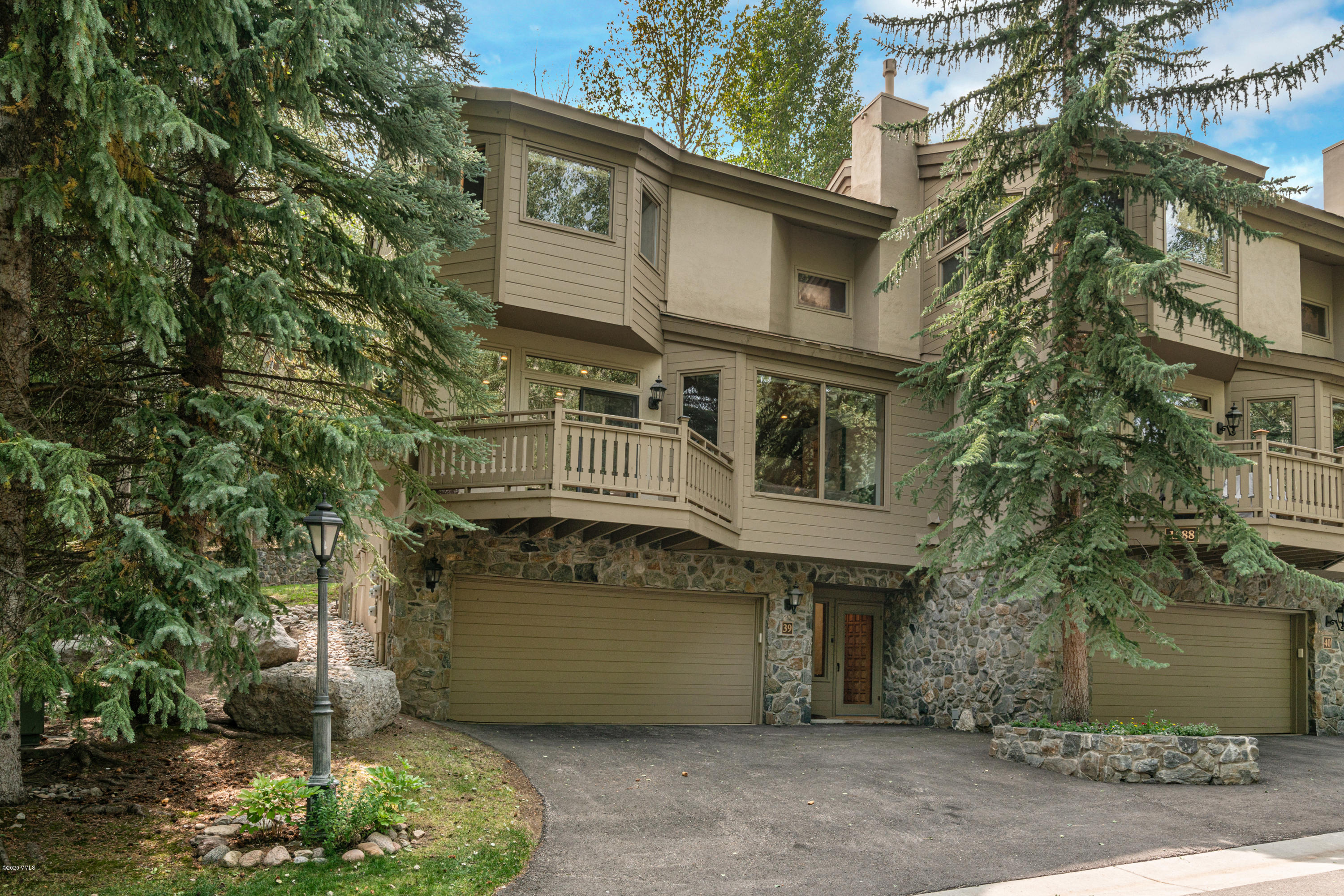 Opportunity to own a beautifully remodeled, contemporary Vail Golf Course Townhome that is light, bright and furnished.  This mountain modern retreat has been remodeled and reconfigured to maximize the space and storage with hidden closets thus no shortage of room for all the gear of the outdoor enthusiast, while still maintaining a clean look. There is plenty of space for the whole family, including the upstairs loft that has been turned into a 5th bedroom with a full bathroom  (although may be a non conforming entrance), pull out wardrobe closet and a gorgeous view of the Gore Range. Enjoy the largest patio in the Vail Golfcourse Townhomes with a gas fireplace and side yard, enclosed with a stone wall and shrubs for added privacy.  Other features include tons of added canned lighting throughout for a gorgeous bright feel, Sonos built-in sound system, modern gas fireplace in the living room, nest thermostats and completely renovated bathrooms.  The remodel added bathrooms so that all bedrooms have their own bathroom. This is an ideal layout for having many friends and family gather. The Vail Golf Course Neighborhood is one of the most unique locations in the Vail Valley and has some of the most majestic views of the Gore Range Mountains. The Vail Golf Course is located immediately adjacent to Vail Village's Golden Peak ski base. This beautiful golf course community is home to some of the Vail Valley's first residents, many of whom formed some of Vail's original businesses. Why would the earliest locals select this area and remain for so many decades? Due to the unique location that includes the only bus route in Vail (other than the in Vail Village route) that drops you right at the ski school and ski slopes in Vail, rather than at the transportation center. In addition, it is the shortest route of all the free Vail shuttle routes making an already convenient ride even more so. In the summer months you can just walk or ride your bike to the Vail Village, or take in a Bravo Vail! or Dance event at the Ford Amphitheater, which is located between Vail Village and the Vail Golf Course and offers many concerts, special events, and performances throughout the year. In addition to Gore Creek running through the area and prominent views of the Gore Range, the Vail Golf Course neighborhood is home to the renowned public Vail Golf Course, which also operates as a cross country ski area in the winter time and has a great restaurant and patio for enjoying great food and drinks. The Vail Golf Course offers some of the most sought after property locations in the Vail Valley. Please visit mls.VailGolfCourseTownhome.com for complete details.