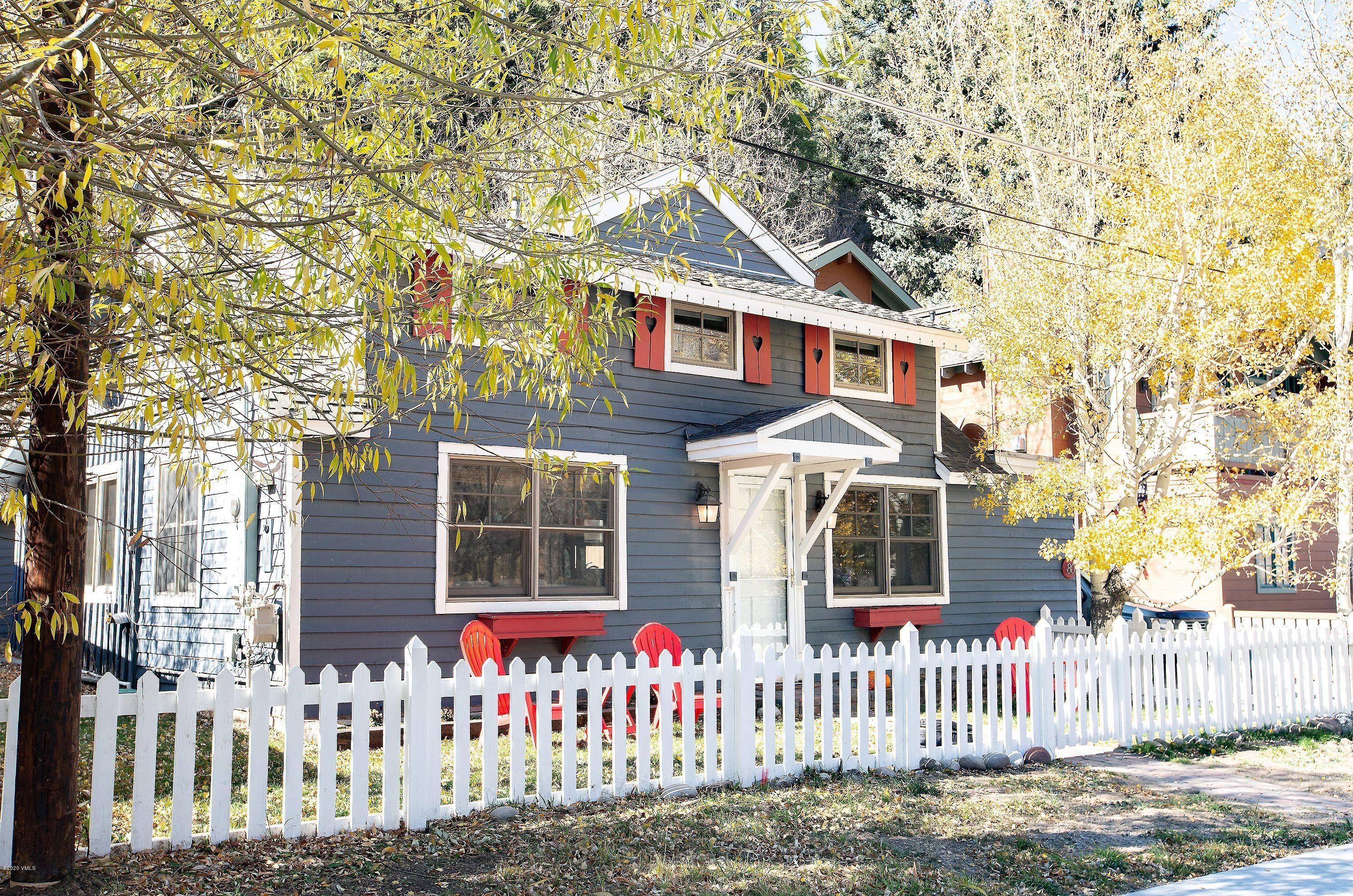 This beautiful and inviting home in Minturn will dazzle you with its feel of warmth, comfort and convenience. Features include a main floor primary bedroom, two bedrooms on the second floor with a large bathroom, wood floors, a main floor laundry room, mud room and two fenced in yards. Located on the South side of town, it's a quick 10 minute walk to the shops, restaurants and Farmer's Market. In addition to how the natural light fills this home, you will love the large fenced in backyard as it is great for entertaining your guests and their pets, not to mention the amount of storage for all of your toys with the additional two sheds being sold with the home. Enjoy the short walk to Little Beach and the serenity of the Eagle River. For those that love Minturn, this is a must see.