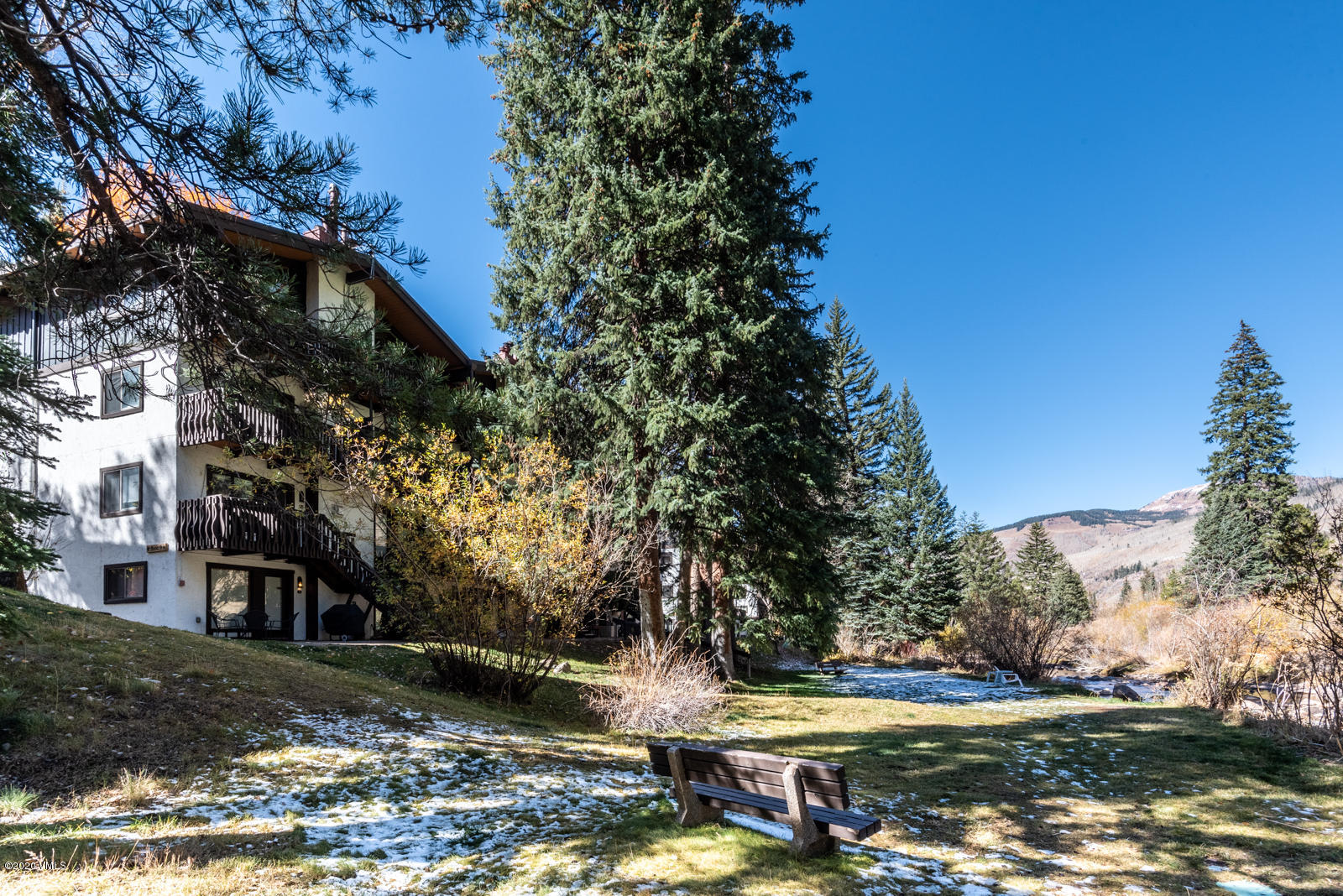 Enjoy your own private area of the Vail Racquet Club and relax on the patio or the expansive lawn directly on Gore Creek.  This furnished updated 1 bedroom is ready to move right in.  The floors are grey wood-grain laminate for easy care.  Gas heat and there is a $3,000 VRC fireplace reimbursement incentive for the buyer to choose the fireplace design.  The entrance is on the north/creekside so no climbing stairs.  Ski storage closet at the condo and VRC bike storage is available.  Owners can have pets and rent their condo short term through the on site management.  Close to a heated outdoor Olympic Swimming Pool, Hot Tubs, Fitness Facility, Tennis Courts, Restaurant, Bighorn Dog Park and Free Bus to Vail Village for Skiing, Boutique Shopping, Fine Restaurants and Live Entertainment.   Your Vail mountain condo on Gore Creek is ready for you!