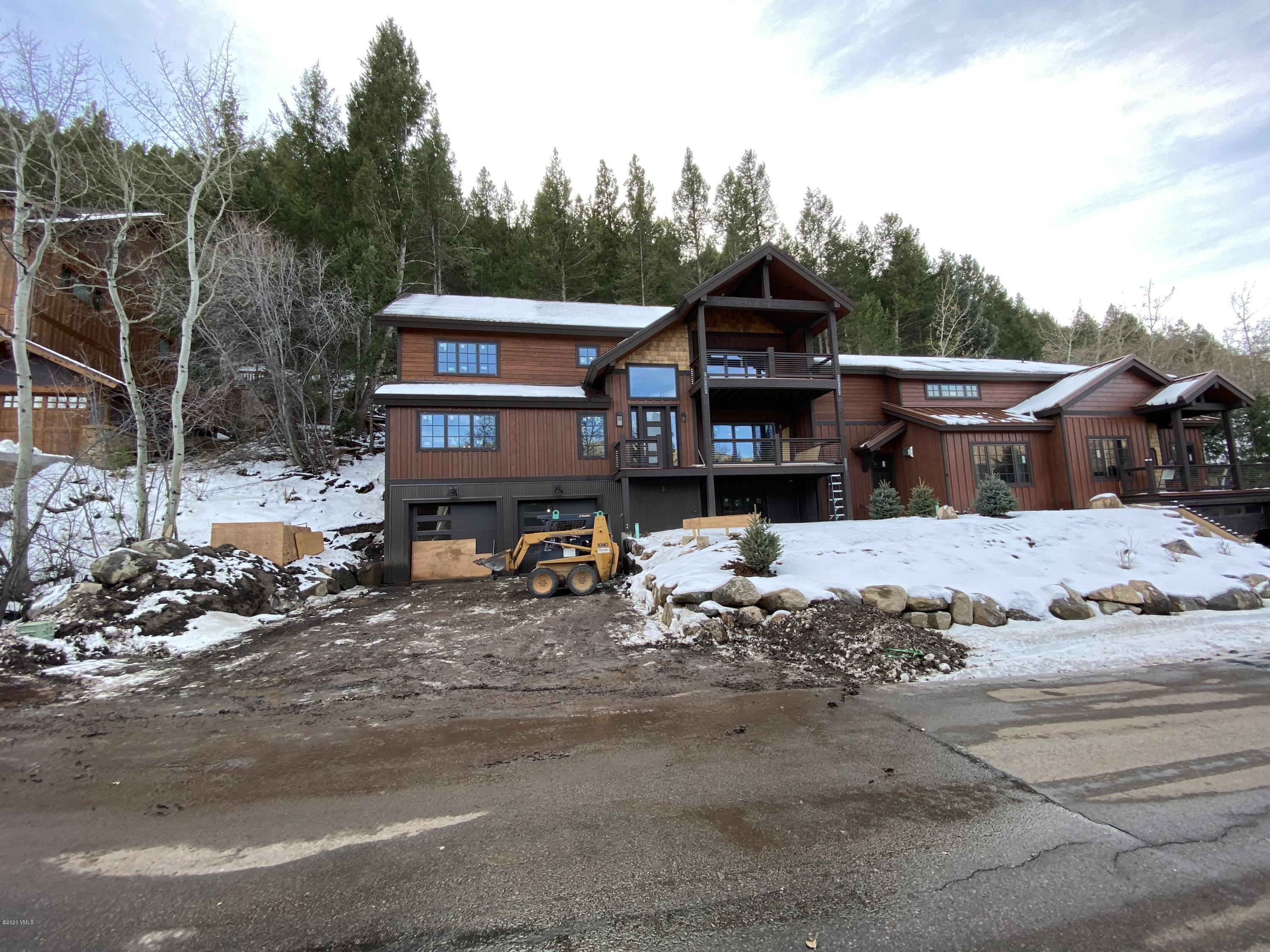New Construction, great open floor plan with additional flex room on lower level with a 3/4 bath that could be a large 5th bedroom.  Wonderful built in benches and cubbies create a large mudroom for residents with outlets for boot warmers.  Large oversized heated garage, over 600 square feet with 10ft high ceilings and separate garage doors. Many other great features such as a large pantry/laundry room next to kitchen with extra counter space for food prep and storage, and a built in pantry at kitchen with multiple turn style shelves, a must see.  Top of the line finishes and details throughout with top of the line Kitchen Aid SMART appliances, SMART LG Washer/Dryer, radiant in floor heat, custom cabinetry and granite counters throughout. 9ft high and vaulted ceilings throughout, with tongue in groove wood ceilings in some rooms.  7ft doors, free standing tub & Rain Head shower in Master Bath. Hot tub included and will be placed on patio. To be completed by end of 2020, if not sooner.