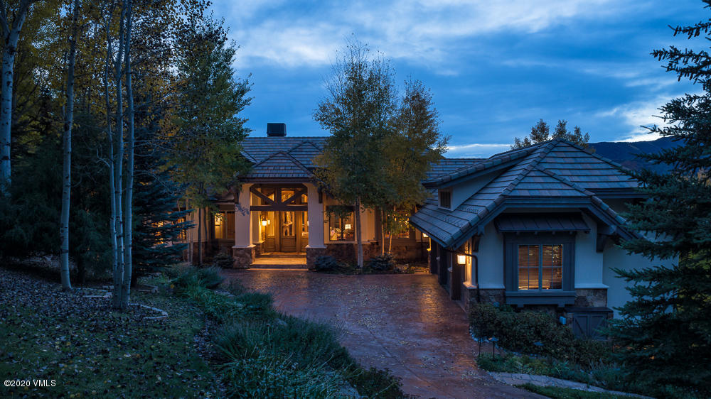 Unquestionably one of the finest homes in the Vail Valley! No element is misplaced in this Scott Turnipseed designed and built home featuring towering volume throughout with expansive two-story glass bringing in majestic mountain views. All five en-suite bedrooms are oversized including a main floor master, two junior master suites with a third oversized bedroom downstairs and a two room lock off accessible from the main residence or an exterior heated walkway. Other features include a generous kitchen and hearth room, two-tiered family and game room, private main level office, five fireplaces, abundant built in storage, extensive outdoor entertaining spaces with a large fireplace and Jacuzzi tub, three car garage and A/C and humidification. This home is offered fully furnished with timeless Ralph Lauren furnishings. Truly a magnificent home sitting on a private 4.5 acre site laden with Aspen and pine trees.