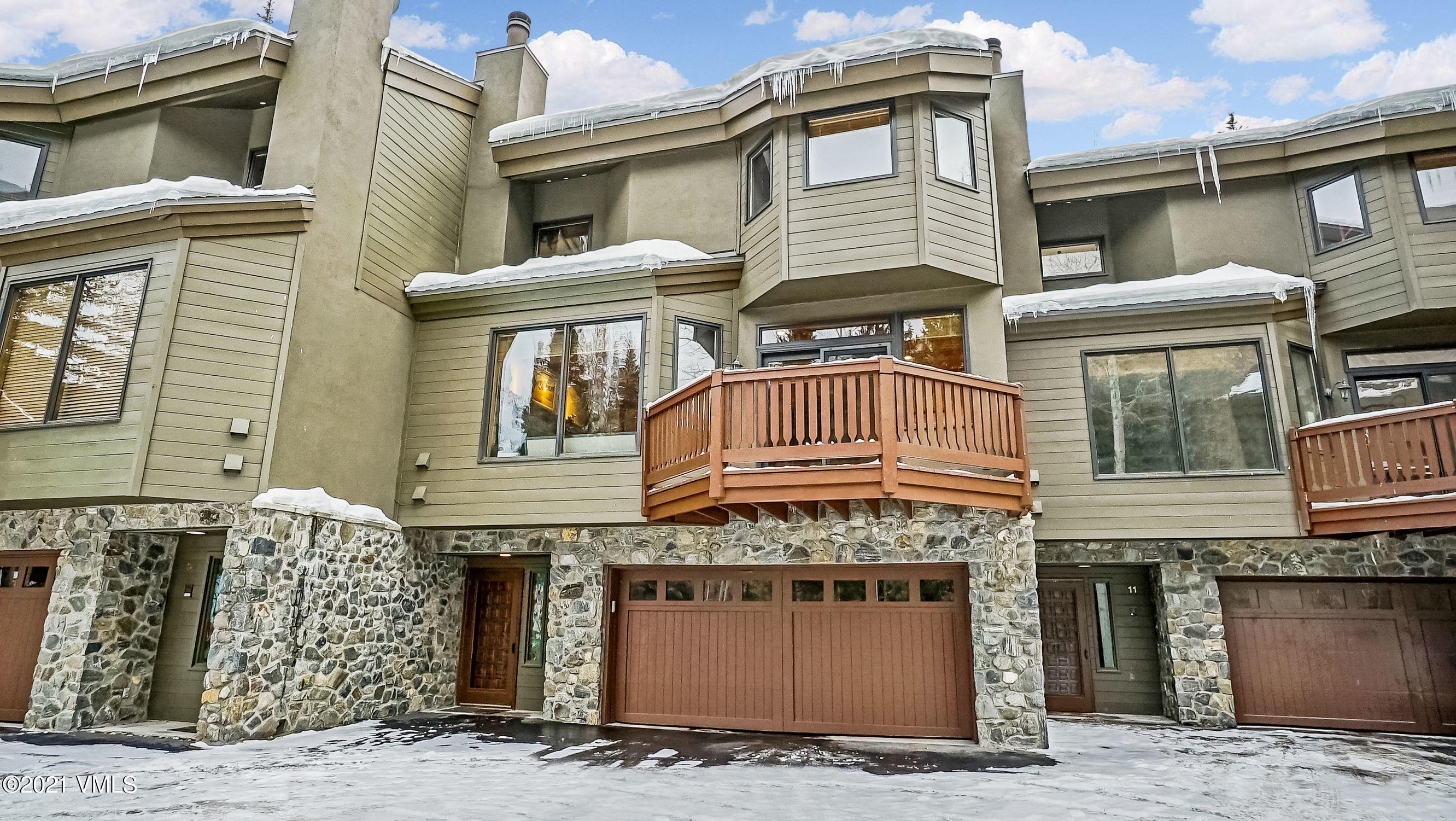 Just steps from the Vail Golf Course Clubhouse and Winter Nordic Center, this well-appointed 3-level townhome provides everything that you need to enjoy the Vail area. The home is conveniently located close to a Town of Vail Intown bus stop that will take you directly to Golden Peak, Ford Amphitheater, Betty Ford Gardens, Vail Village Center and Lionshead. The living area, with a wood burning fireplace and an extra space for a card/game table, is located on the 2nd level as well as a dining area, large open kitchen with maple cabinetry and a breakfast bar, a laundry room with sink, a wet bar, a powder room and a balcony. The master bedroom, with ensuite bath, is located on the 3rd level along with 2 additional bedrooms, a 3/4 bath and a jacuzzi room. The spacious master bedroom has vaulted wood ceilings and his and her closets. The beautifully updated master bath has a double vanity with quartz countertops, heated floors and a large shower. The additional 2 bedrooms each have vaulted ceilings and there is a skylight for added natural sunlight in the hallway. The lower level houses the front entry area, a large 2-car garage, a family room and 4th bedroom with ensuite 3/4 bathroom and additional storage. This immaculately maintained home has ample space for entertaining large families or groups of friends. The Vail Golfcourse Townhomes have the ability to enjoy the conveniently situated outdoor swimming pool, located next to the Fall Ridge condominium complex, during the summer months. In this quiet Vail Golf Course neighborhood, you are sure to enjoy all of the wonderful activities that Vail offers in the summer and winter. If you don't want to take the bus into Vail, or Lionshead, it's a short walk, or bike ride, to get to the Vail Village Center; with parks for picnics, walking the dog or just plain enjoying the mountain scenery along the way. The close proximity to the golf course, Nordic center, Vail Village and Lionshead makes for the perfect primary or 2nd home