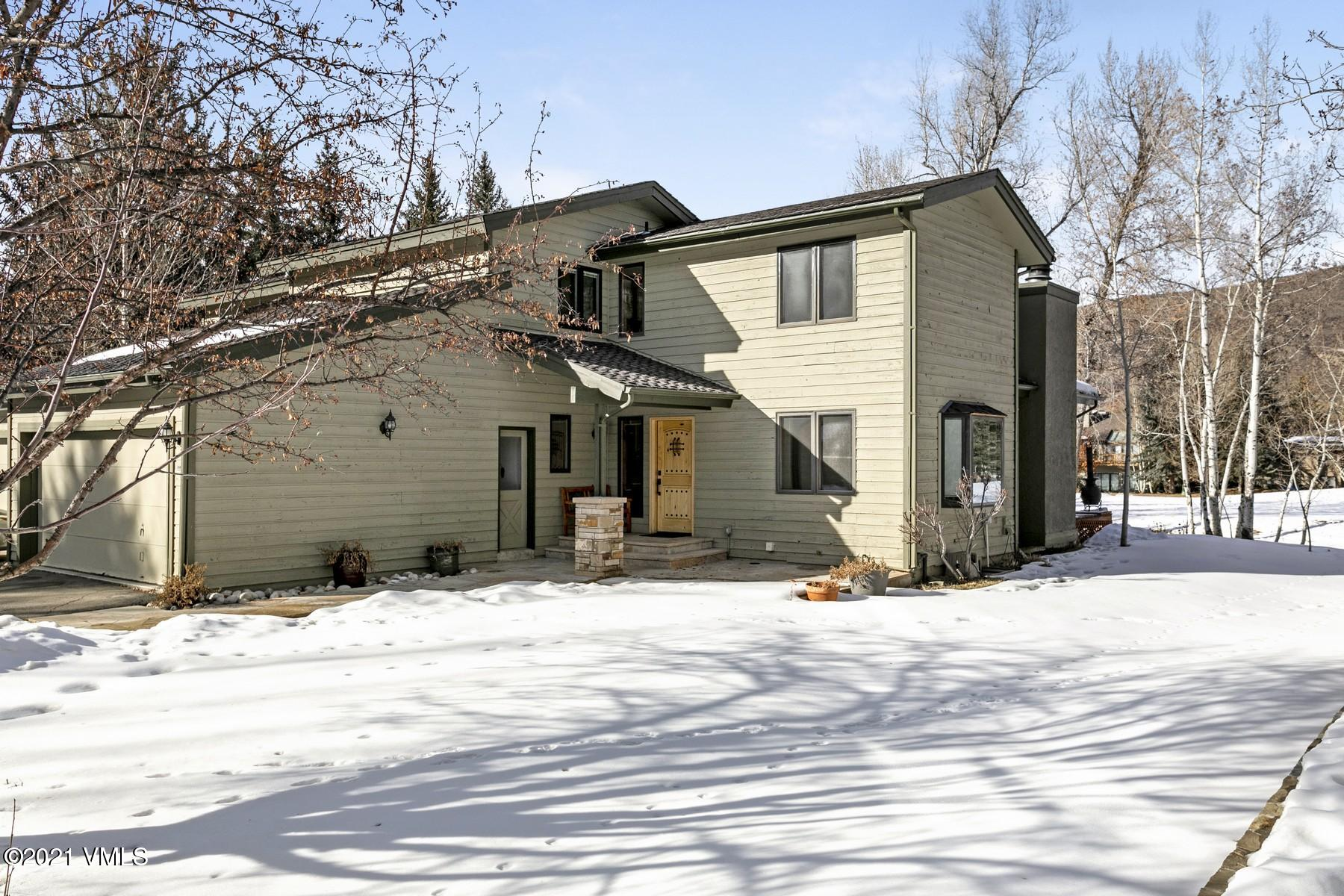 Immaculately maintained, this beautifully-appointed duplex is situated in a prized alpine location, backing to stone creek and on the 6th fairway of the EagleVail golf course. Boasting nearly 3,000 square feet over 3 levels, this property features 3-bedrooms plus a main level office, 4-bathrooms, vaulted ceilings, hardwood floors, a lower-level family room, wood-burning fireplace, gas stove, air conditioning in the master bedroom, spectacular outdoor space, and much more. Just a ten minute drive from Vail and five minutes from Beaver Creek, EagleVail is a popular mountain community in the center of everything. Extensive amenities add to the warmth of the neighborhood with the EagleVail Golf Club, Willow Creek Par 3, Pool, numerous Parks, Tennis/Pickle-ball Courts, the Pavilion, and the renowned EagleVail Trail. It is rare to have such a convenient and accessible mountain property in a generally flat location on the valley floor, with an abundance of outdoor recreation at your fingertips. Please feel free to visit mls.573StoneCreekDrive.com for more information.