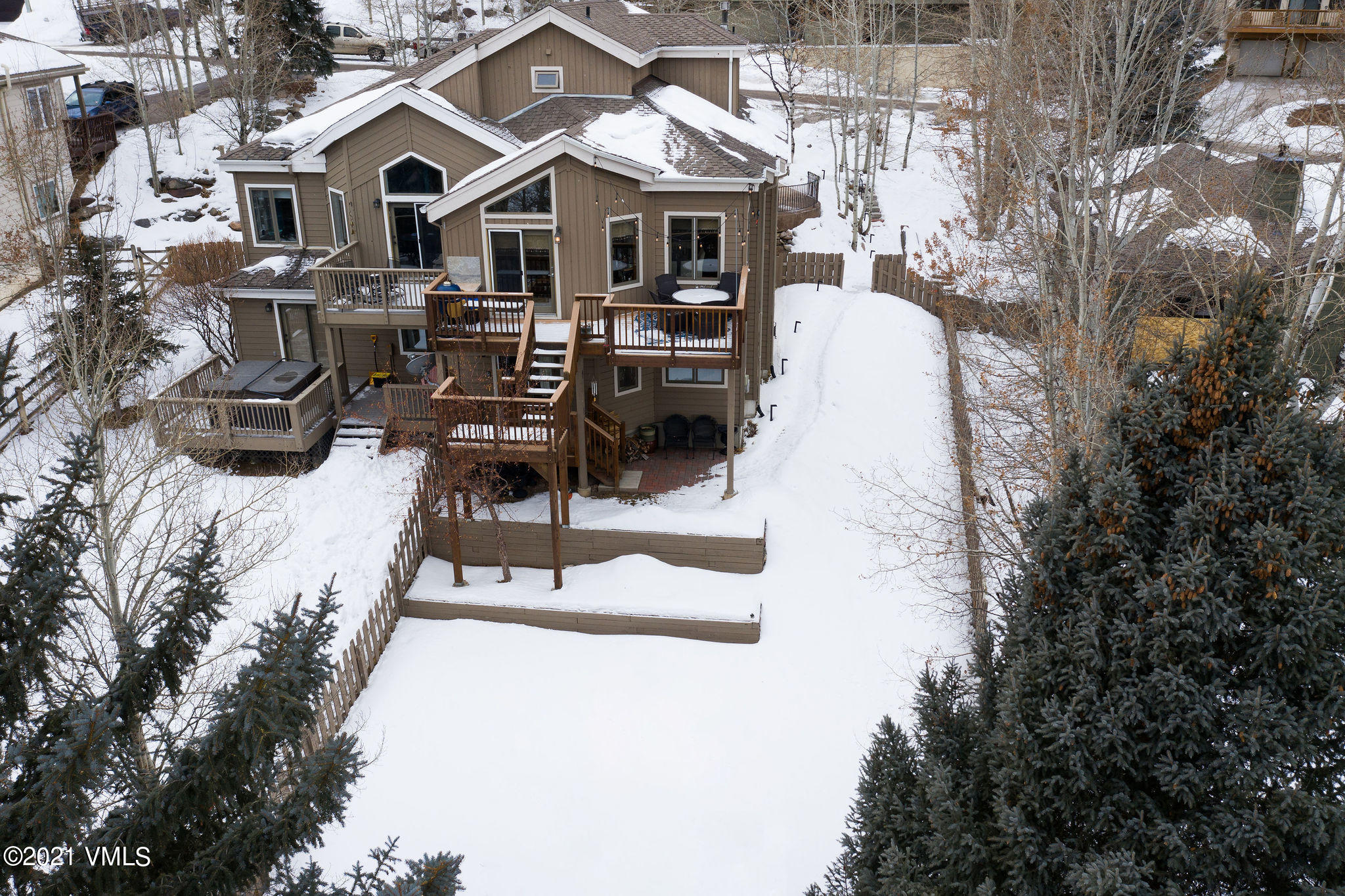 Enjoy this special setting in EagleVail close to the West park.  This well cared for 3-bedroom duplex has a large fenced in yard and northern views.  The primary bedroom has the whole top floor offering privacy. There is a new full kitchenette downstairs, and an additional media room.  Soak up the late afternoon sun, and enjoy lush landscaping in the summer months.