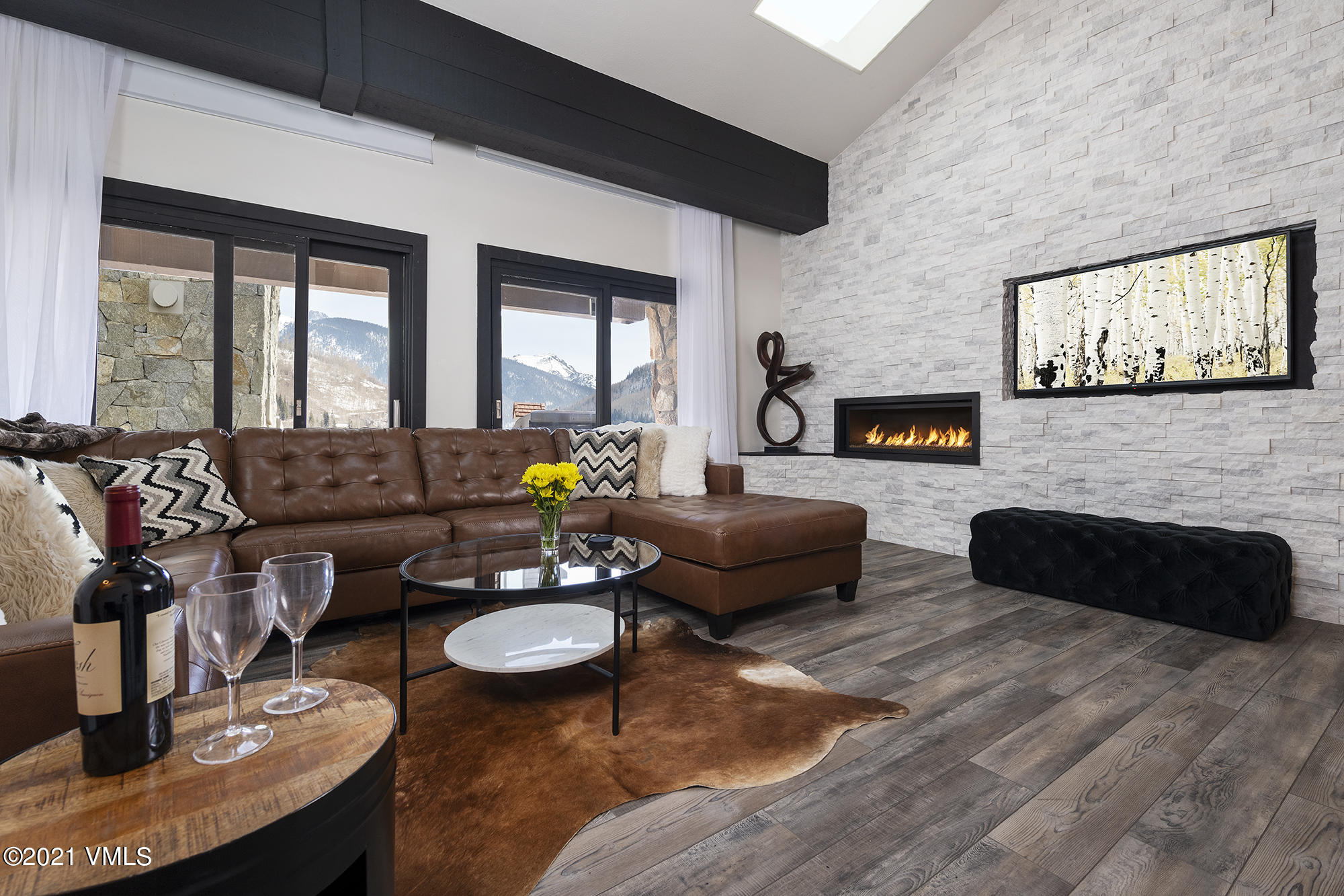 Enjoy penthouse living at The Enzian in the heart of Lionshead Village! This completely remodeled, top-floor end unit has vaulted ceilings creating vertical volume and skylights streaming in sun at just the right angles throughout the day.With 5 bedrooms plus a loft for additional sleeping or a kids play area and movie room, there is space for everyone!  Luxuries include 2 assigned underground parking spots, an elevator and owner-useage of the Landmark's pool and hot tub. With solid rental history, ample owner storage, and furnished with contemporary decor, this is a must see!