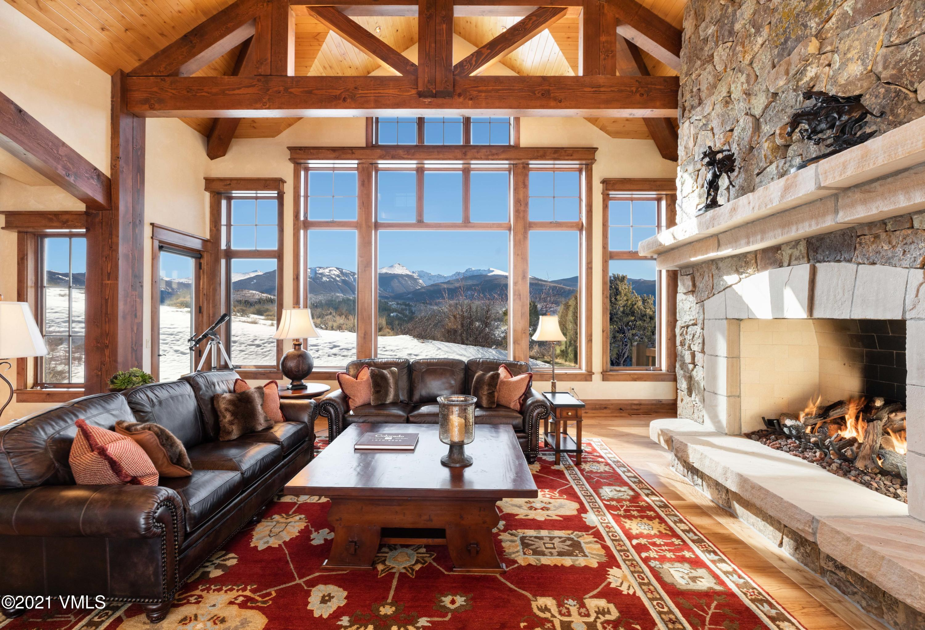 This beautiful, thoughtfully designed home boasts unique, magnificent, 270-degree views of the Sawatch Range, Flattop Mountain as well as New York Mountain and beyond. Located on The Divide Side of this community offering sunny southern exposure, no expense was spared when this residence was built. Property features an open-concept floorplan with stunning great room that frames the majestic views; adjoined dining room, kitchen and hearth room. Large kitchen with top of the line appliances; custom cabinetry; granite countertops. Main-level primary suite and office; large bedroom suites all with en-suite bathrooms; lower level family and entertainment area; laundry on main and lower level; concrete tile roof; air-conditioning and humidification throughout. Expansive outdoor spaces for entertainment or relaxation with privacy from neighboring homes. Private gated community with security and many amenities plus availability to join one of the best golf clubs that the Vail Valley has to offer.