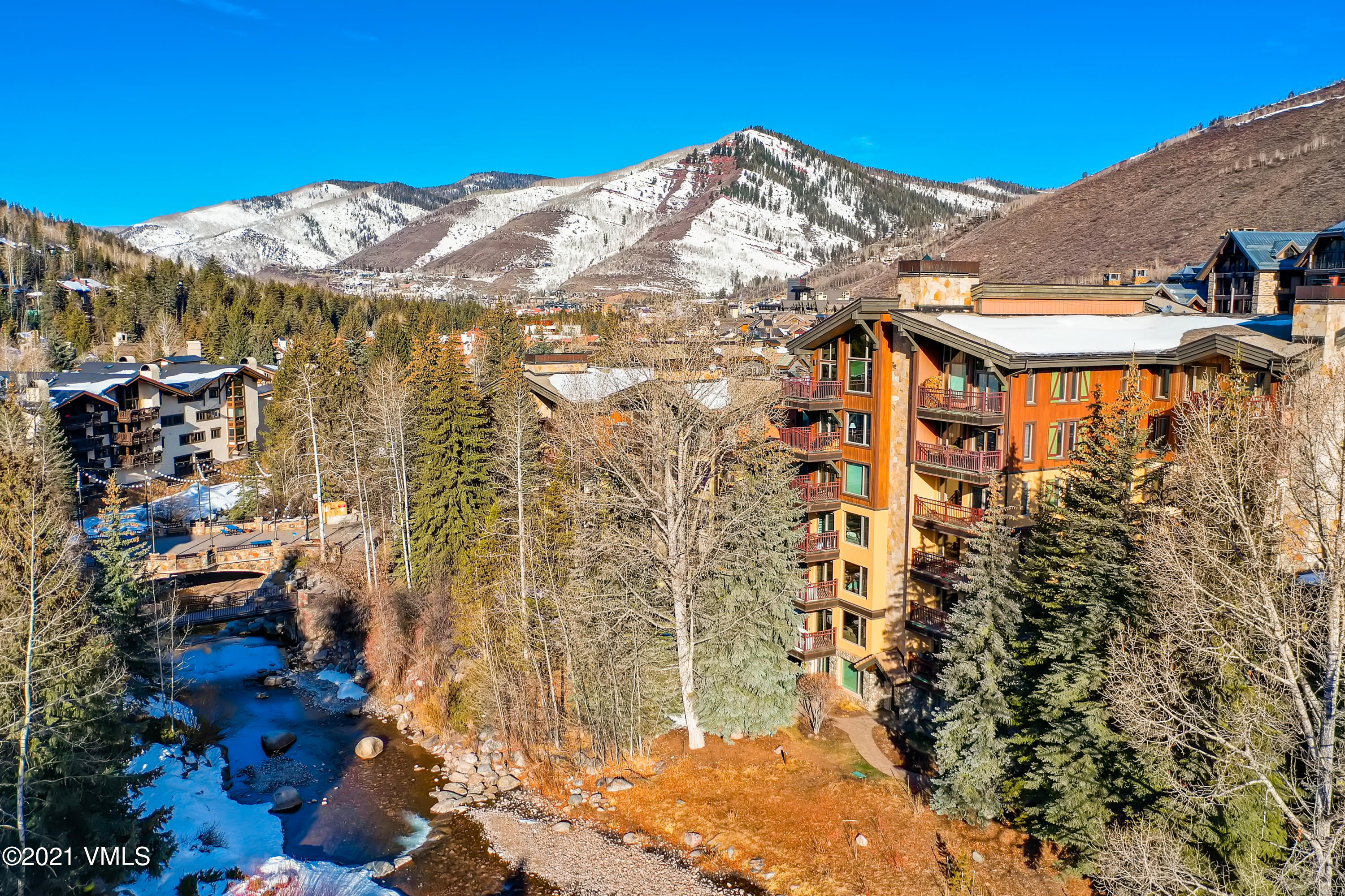 This premier, 3-bedroom, Vail residence is situated in a location to boast about! Whether you are heading out to hike the mountain, visit award winning restaurants, or to enjoy the Vail Farmers Market, you'll arrive within minutes from your Village Center condo.During the summer, you're just as likely to catch a glimpse of tourists floating down the creek on innertubes as spotting some enthusiastic fly fishing on the gold medal water. Winter months will have you gazing from the spacious living room over the icy Gore Creek to take in the skiers racing down Golden Peak. The master bedroom features one of the two gas fireplaces as well as its own private balcony. The second bedroom is spacious enough to host two twin beds or bring them together for a second king. On the main level, with its high coffered ceilings, the third bedroom can easily convert from bedroom to office and back again. Not interested in working while in the mountains, an easy remodel could turn this into the ideal bunkroom location.Curious about the details: since installing new appliances, including a Bosch oven and induction cooktop five years ago, this condo has had light owner-only use. Carpets were replaced just months ago, furniture and furnishings are all included down to the silverware. This condo is ready to move into. Just pack your suitcase and enjoy your next Vail vacation in your new condo!