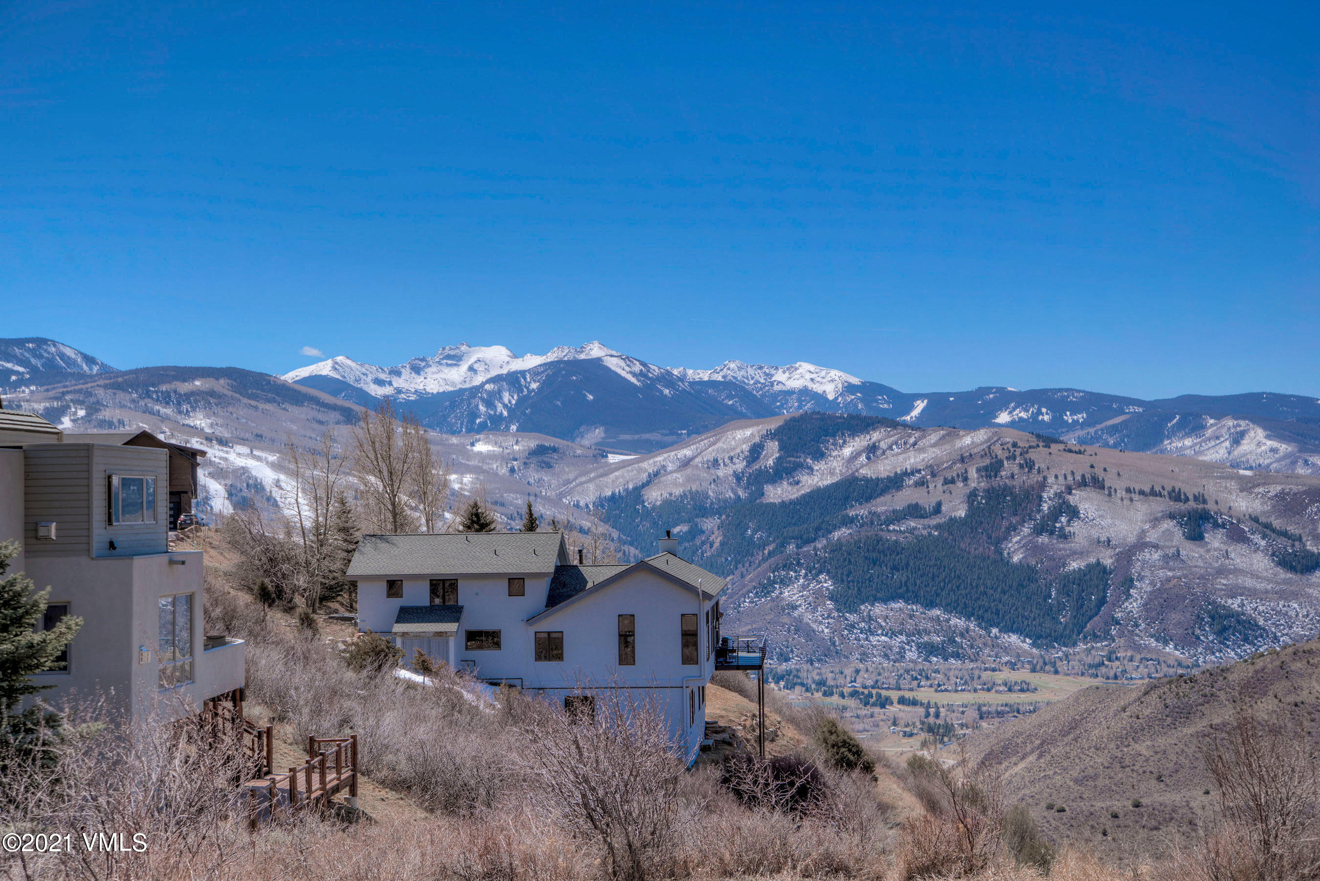 Admire incomparable views of Beaver Creek, Arrowhead, and the New York Range from this incredible single-family log home on almost an acre located in the Vail Valley.  Breathtaking mountain landscapes from every room.  Rare large yard with expansive deck.  Take in the commanding panorama with your morning coffee and dinner at sunset.  Four bedrooms, three baths with separate living areas, a big loft, and a two-car garage. The fireplace is central to the main living area and dining room.  Custom closets have been added throughout the home--new hardwood floors on the main level.  Easy access to pristine Wildridge mountain bike and hiking trails - an exceptional location for outdoor enthusiasts.