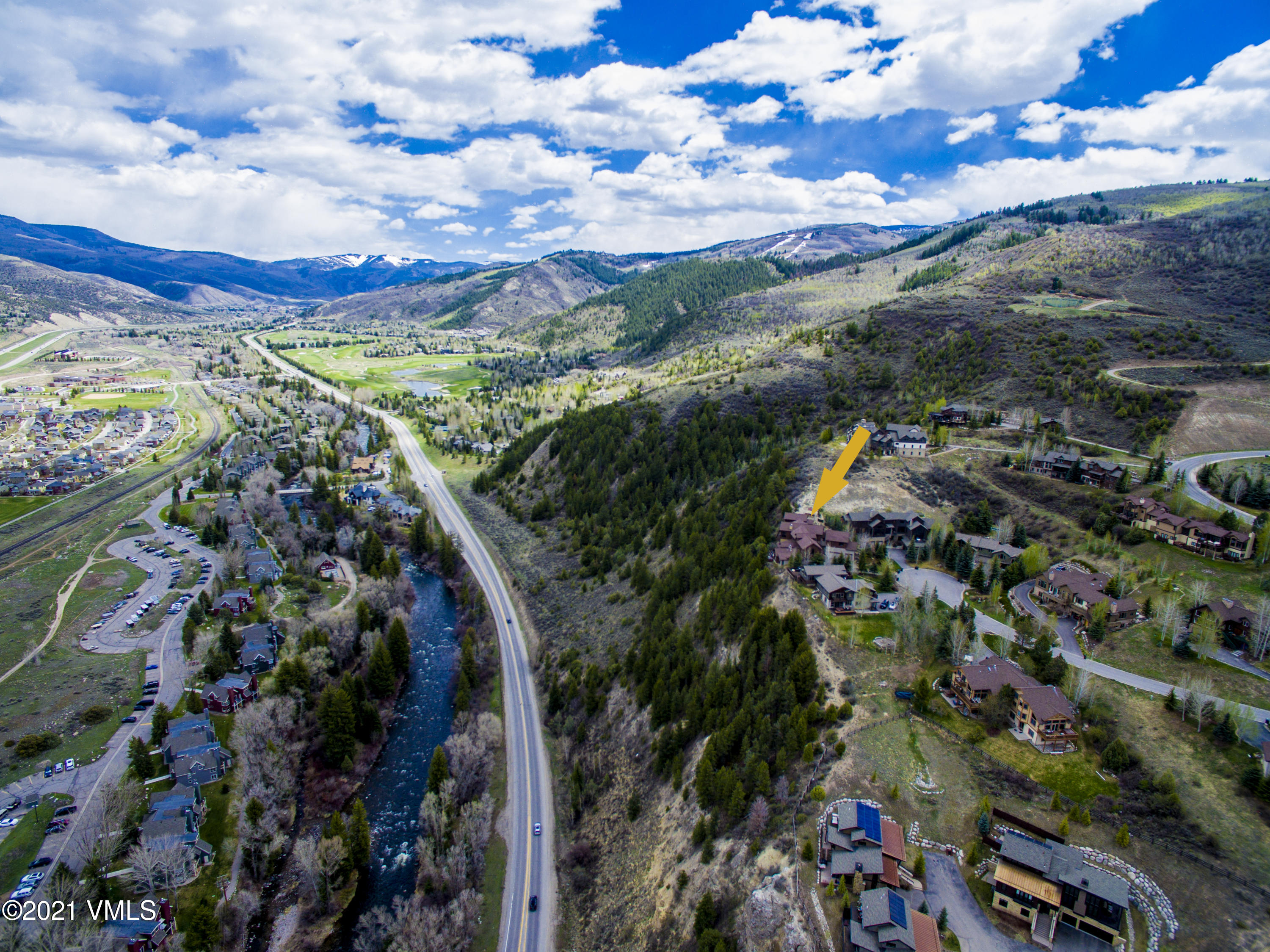 This Homestead duplex has excellent views of Game Creek Bowl and the Eagle River from the great room and the primary suite on it's own floor.  The large kitchen has been renovated and offers lots of space to entertain with easy access to the private patio or expansive balcony.  In addition to 4 bedrooms there is an office, family room with a wet bar, 2 laundry rooms and a 3-car garage. This home is located at the end of a cul-de-sac in a quiet neighborhood and close to all the amenities of Edwards.