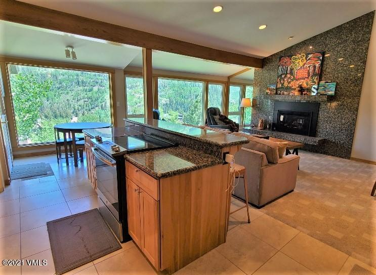 One of the most stunning locations in Vail with huge views of the ski slopes, this is the perfect sized penthouse unit in a very quiet location. South facing with lots of light, and just a short walk to Lionshead Village, these units are very rarely available.   With a recent remodel and light owner use, this home also has a new $25k picture window, a new gas fireplace which can heat the whole unit, and a two year old water heater.  Two deeded covered parking spaces and two outside lockable storage units for bikes, skis, golf clubs etc. are a huge bonus. And only steps to the free Town of Vail bus stop.  Don't miss this opportunity to secure your superb Mountain Lifestyle.