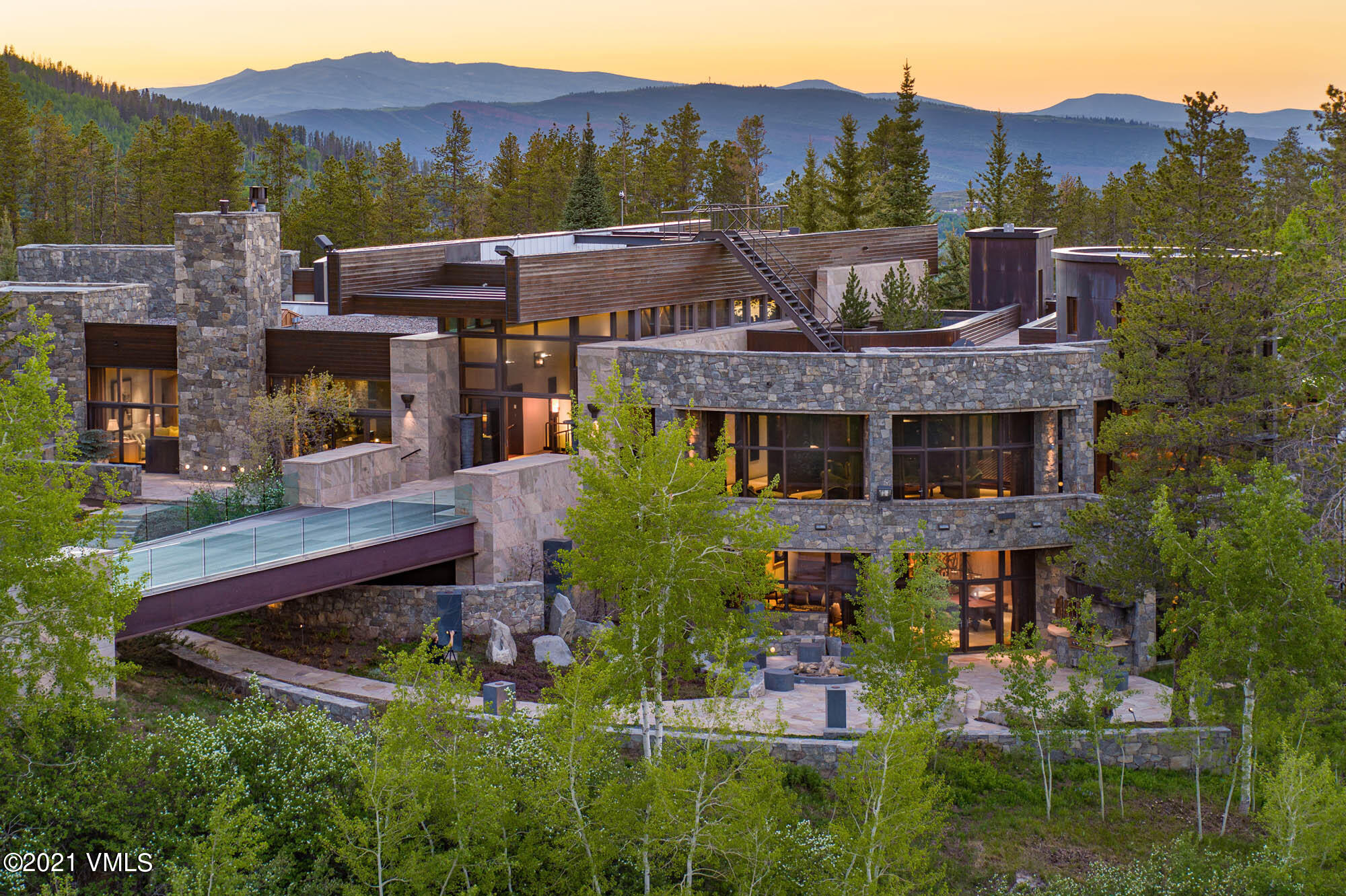 Main House- 30,350 SF- 8 beds | Coyote Lodge- 27,850 SF- 1 bed | Ridge Guest House- 5,321 SF- 4 beds | Cabin Guest House- 3,275 SF- 3 beds | Apartments- 1,335 SF- 2 beds | Car Barn, Toy Storage- 7,113 SF | Casteel Creek is one of the most unique mountain experiences in the world, a destination in and of itself. With 250 acres bordering 2 million acres of National Forest, the estate bestows an ambiance of seclusion within the Rocky Mountains while, in fact, is located within the heart of the Vail Valley. World-class skiing, shopping, restaurants, and entertainment in Vail and Beaver Creek are minutes away should one ever wish to leave Casteel Creek's own adventures... snowmobiling, cross-country skiing, ATV explorations, mountain biking, hiking, shooting, fly-fishing, rock climbing and more creature comforts than one could imagine. Meticulously appointed, the estate affords a life without compromise, where grand entertaining, privacy and convenience are paramount. A scenic drive through the forest culminates over a dramatic million dollar bridge that sets the perfect tone upon arrival to the main house. The residence features a 200-ft steel viewing bridge that suspends mid-forest for taking in views of the Sawatch Mtn Range and sounds of the creek below. Providing 8 en suite bedrooms plus ice cream parlor, theater, cowboy saloon, spa, exercise facility and multiple outdoor entertaining areas. There is also a 27,000+ SF entertainment venue with climbing wall, pool, shooting range, catering kitchen, formal living and dining, teppanyaki dining area, bar and game room plus indoor fieldhouse. Outside is a trout stocked pond, soccer field, patios, hot tub, playground. To complete Casteel Creek are 2 guest houses, 2 apartments, western town center with sheriff's office, car barn, 17 snowmobiles, 3 ATVs, snow plows for grooming miles of trails.  Casteel Creek enjoys ease of access to Vail Airports or Denver International Airport. mls.CasteelCreek.com Casteel Creek enjoys eas