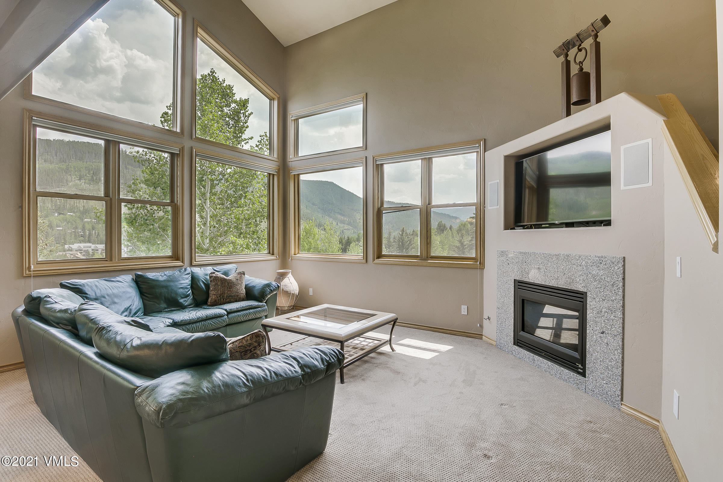 This is the perfect location in Vail - the sunny side- where the sun doesn't disappear behind the mountains!!! If you love light, bright, and sunshine this is your home!!! Enjoy the expansive views from the Gore Range to the runs of Beaver Creek, from the outside deck, dining room and living room!!! A wonderful sense of calm, relaxation, and beauty! This ideally located home is on a quiet cul-de-sac which borders the National Forest and is steps away from the North Trail, where you can walk your dog, hike, mountain bike, and snowshoe! The levels in this Wonderful Garmisch drive home is perfect for privacy for you and your children or your guests!!!! Everyone has their own space, which makes this home feel even bigger and more like a mountain retreat!! Natural light drenches all 3 levels of this cheery, very comfortable, and extremely well taken care of home!Radiant heat is on all 3 levels!The two car garageprovides plenty of room for all of your mountain toys! Vail skiing is just a few minutes away as well as grocery, dining and shopping.Once you visit 2338 B Garmisch you will immediately feel that you are Home!!