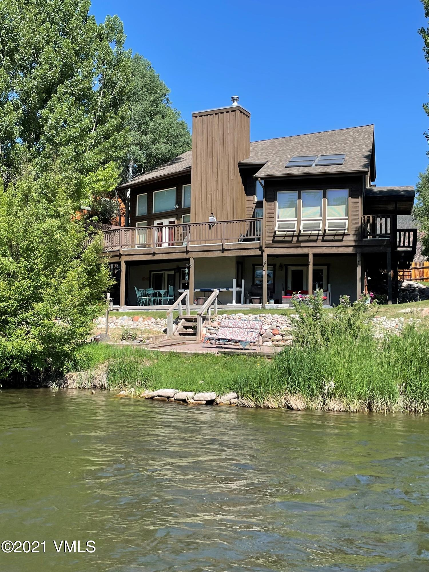 3400 sq.ft. Single Family on the Eagle River! Incredible setting and mountain views. The main floor features a large great room, with tons of natural light, vaulted ceilings and a floor to ceiling river rock fireplace, a sun- room and large deck overlooking the river, a bedroom and bath.  2 beds & bath on 2nd floor.  Lower level-1 bed-1bath, full kitchen with lock-off potential.  Lots of Recent upgrades! New Roof, New Water System, New LVT Flooring on lower level.   Offered at $835,000