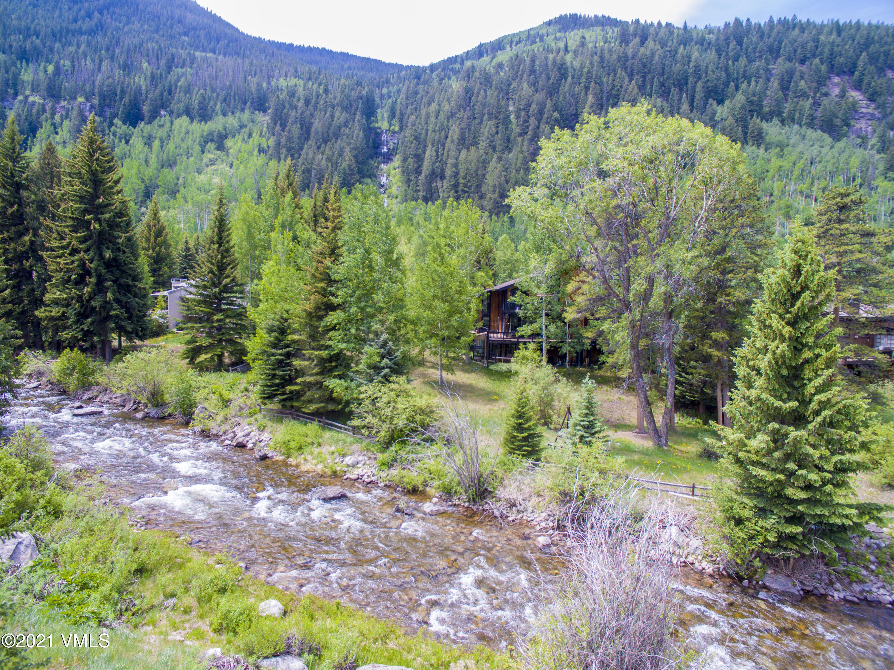 Prime .879+/- acre redevelopment opportunity with 217+\- feet of Gore Creek frontage as well southern views to an idyllic waterfall. This East Vail parcel is conveniently located close to the Town of Vail bus, with views up the Pitkin Creek drainage to the Gore Range, and offers a gently downward sloping lot in an idyllic alpine setting. Both sides of the duplex (R011260 & R011255) are included in this offering, zoned two-family residential, with substantial GRFA to accommodate a single family home or duplex.   Property is being sold 'as is'.