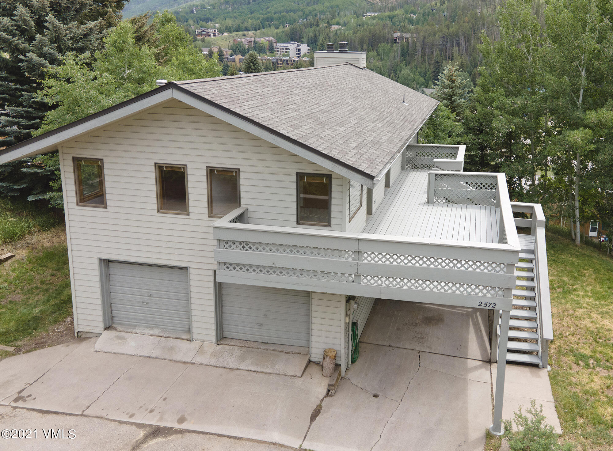 Wonderful single family home that can be split into 3 separate units. 2 bedroom, 1 bath upstairs, 2 bedroom, 1 bath on lower level, a middle level with 1 bedroom and 1 bath. 3 separate decks, sunny, South-facing, mountain and valley views. 2 car garage plus carport and surface parking. On the bus route.  Owner has rented this, under market to long-term tenants for  $4795/mo. New owner can live in part, rent the other part of the house, or just have lots of room for family and guests.Lot allows for large expansion of house, to almost double the existing size.  Great candidate for staff housing.This is currently the lowest priced single family home in Vail, and is great value.