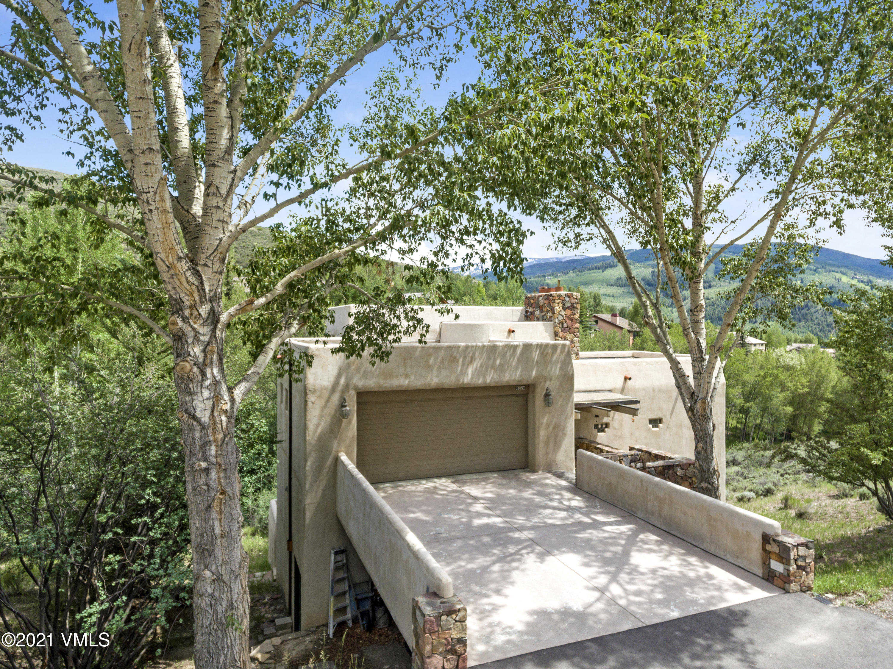 First time ever on the market. Some of the best views available of Beaver Creek and Arrowhead ski runs, pond and Singletree golf course.  Property is actually two lots and includes a Tesla power outlet and a Villa Montane/Beaver Creek parking space in the price.  The home is a creative masterpiece of unique spaces through out.  There are 3 outdoor decks and a separate entrance for a mother-in-law area on the lower level. The lower gathering room includes a modern infrared sauna unit and two bedrooms, one with a Murphy wall bed and the bath includes a deep stainless plunge/soaking tub.     Also included firepit / seating area down by June Creek that runs through the property.  Property was built by owner of a stone company and the lovely stone work shows up through out the home.