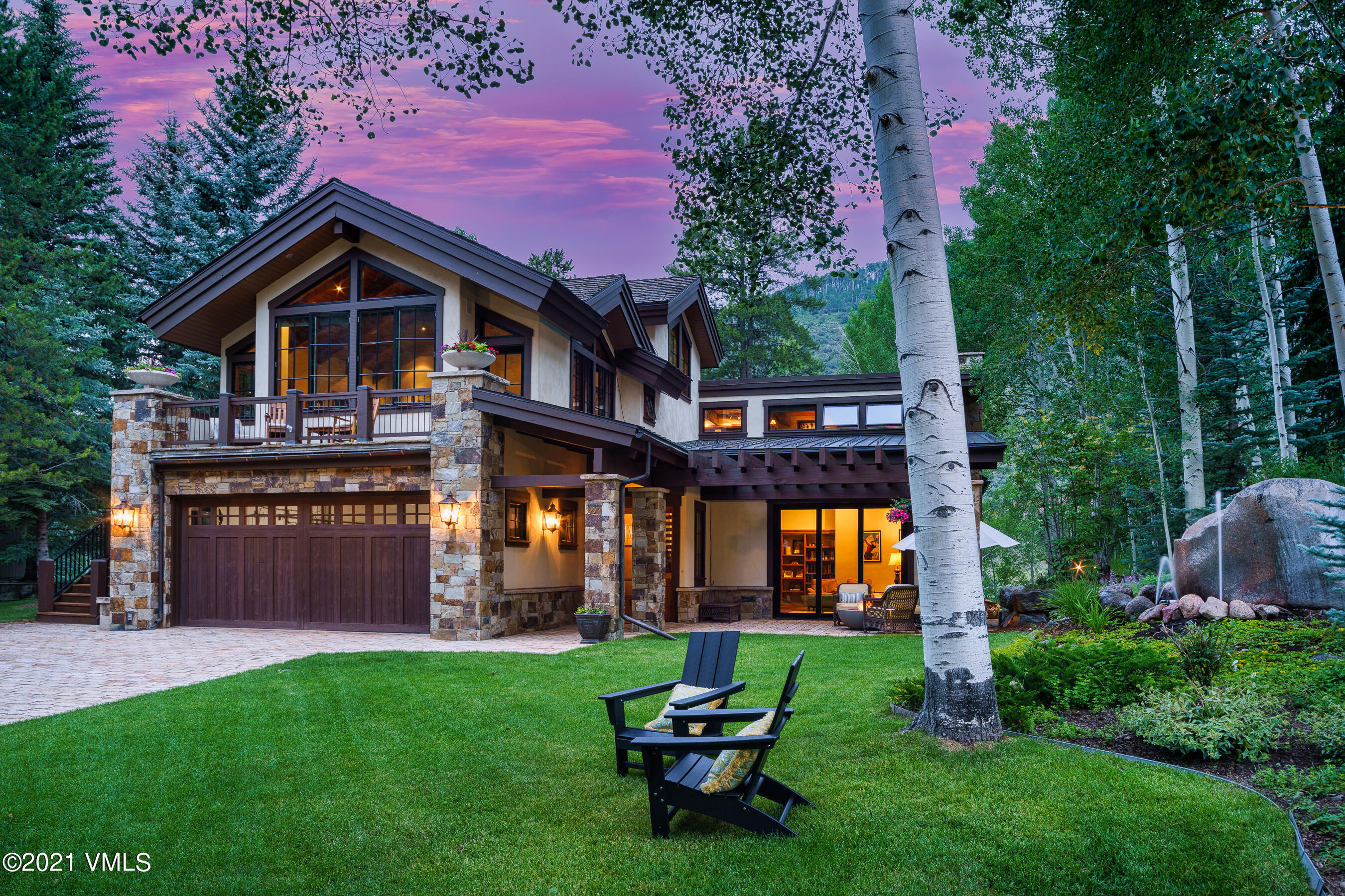 Located in the coveted Vail Golf Course Neighborhood and nestled among mature aspen and pine trees, 1163 Cabin Circle is a distinctive home revealing both quality craftsmanship and elegant aesthetics. This expansive sanctuary was recently remodeled and features 5 ensuite bedrooms, a newly renovated chef's kitchen, billiard room, library, gym, office, and bonus room. Built as an open concept, the communal spaces effortlessly flow into one another, allowing for easy living. Indoor-outdoor spaces including a pergola covered patio, living room with fireplace, several decks, and a hot tub make this home ideal for entertaining guests in every season. The heated driveway makes snow removal a breeze!This pristine and private mountain retreat boasts expansive mountain, neighborhood, and golf course views. Situated on a quiet street with close proximity to the best that Vail has to offer, it is a short walk or bike ride to Vail Village, the lifts, Ford Amphitheater, and more.