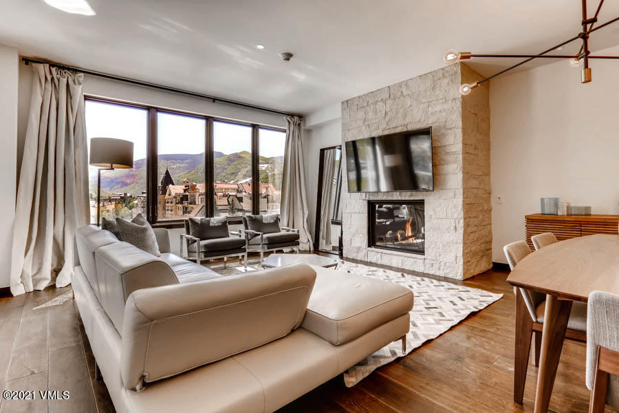 This stunning three bedroom mountain contemporary residence will not disappoint. Brand-new in 2017, E404 boasts designer finishes, two decks offering dramatic views of Vail Mountain ski-slopes by day, and the twinkling lights of Lionshead by night. This 3 bedroom lock off residence can operate as a separate suites for potential rental revenue. The master bedroom adjoins a five piece luxurious bath, private deck and fireplace. The spacious secondary bedrooms with bathrooms en-suite can each accommodate two queen beds, or bunks and offer large closets.  The amenities set this Vail residence apart from the rest, includes a ski concierge with transport to the Lionshead ski base delivering you and your gear with ease, front desk and on-site rental management, hot tubs, indoor pool, outdoor firepit, recreation room and fitness room with Peloton bikes. The condo includes the use of two parking spots, two ski lockers and two secured storage cages. Just a short walk to the Lionshead Plaza, Gondola, or ride the Lion's electric vehicle to Lionshead skiing.
