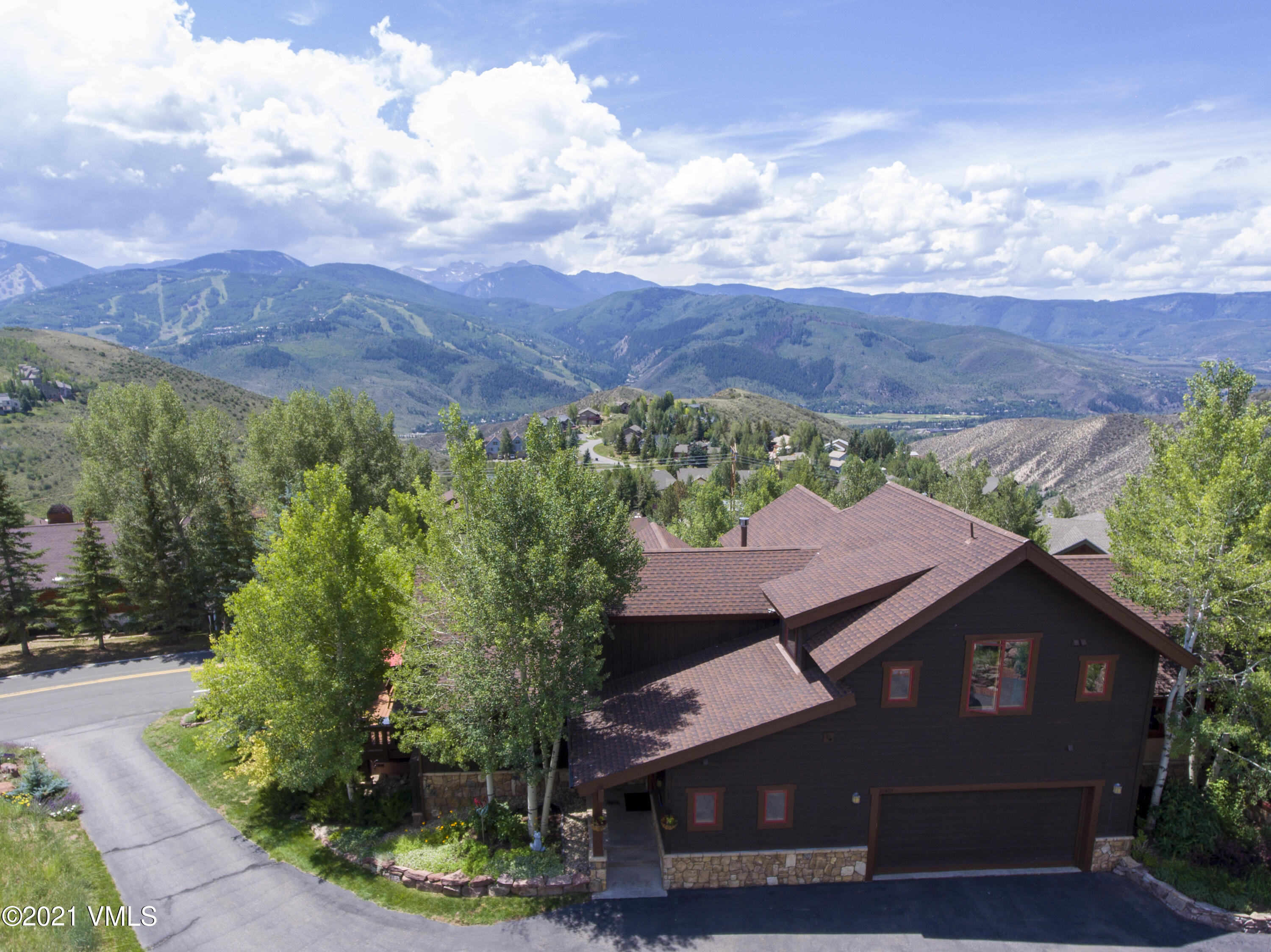 Do not miss the stunning views of Beaver Creek and beyond to Gold Dust peak, part of the Sawatch Mountain Range from this 5-bedroom, 6-bathroom home.  Located on a quiet street in the Wildridge neighborhood of the Vail Valley, the property was built to take advantage of the surrounding mountains.  The vaulted ceilings and large windows on the main level frame your view from the living room, dining room, and kitchen while allowing great natural light.  Step outside to the wrap around deck or backyard and continue to enjoy the views.  The property is unique as it offers three master suites, including a main level master with a private deck.  Two bedrooms on the upper level both with vaulted ceilings.  One is a master suite with views to the south and the other is a very large bedroom with an en suite bathroom.  The lower level has a second living room, another master suite, and a fifth bedroom.  A large projector screen TV and pool table in the lower level are part of the sale making this a great area for entertaining and relaxing.  The fun does not stop inside, as the walk-out lower level gives access to the backyard and hot tub area.  There is extra storage and an oversized two garage.  The home is within walking distance to the Wildridge pocket park, dog park, and the Avon Preserve offering hiking and biking trails.  The Wildridge neighborhood and this home give owners easy access to the White River National Forest for expanded year-round outdoor activities.Recent updates include new carpet throughout, refinished hardwood floors, new paint, and new Fisher & Paykel appliances.  Landscaping updates have been done as well.
