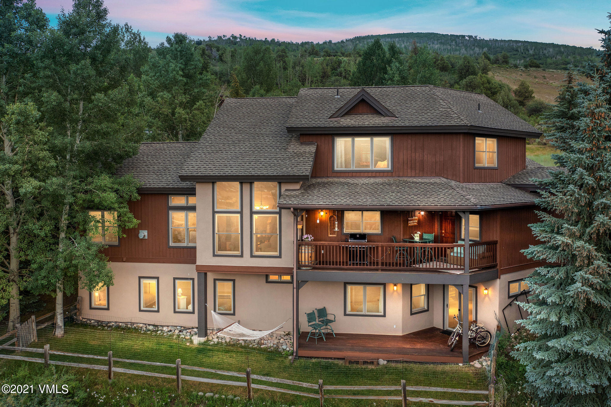 Located in one of the Vail Valley's most desirable communities, and now offered for the first time since new, this beautiful home exudes ''family'' at every turn.  Just steps through the front door you'll smile at the wonderful sense of arrival.  Awash with natural light provided by floor-to ceiling windows, the main level features newly refinished hardwood floors and a wonderful sense of space accentuated by the cathedral ceilings.  All of these complement an open, flowing floorplan which provides the perfect setting for gatherings of your family and friends, topped off by outstanding views which sweep as far as the eye can see from east to west.The main floor includes living/dining/kitchen areas which flow seamlessly from one to the other.  Outdoor living areas abound on this floor, including a spacious private patio area which will become your favorite for enjoying morning coffee, dinners al fresco, and apres ski hot tub sessions.  You'll also treasure the covered deck, located just off the kitchen, featuring big views of the valley and mountains beyond.  Wrapping up the main floor is a generous, two car garage which includes room for all of your mountain toys.Upstairs is the expansive primary suite, with walk-in closet and adjoining bonus room that's perfect as an office, nursery or reading room.  You'll treasure the big views from the moment you open your eyes each morning.  A jetted tub and shower round out the suite, one which will become your private respite at the end of each day.  The first level of the home includes three bedrooms, two baths, and a fun, oversized rec room.  A walk out from the rec room leads to the fenced back yard area, perfectly sized for your family pup.  You'll quickly come to appreciate the convenience of calling Homestead ''home,'' with the extensive shopping, dining, some of the Valley's best schools and the Gates of Beaver Creek just minutes from your door.