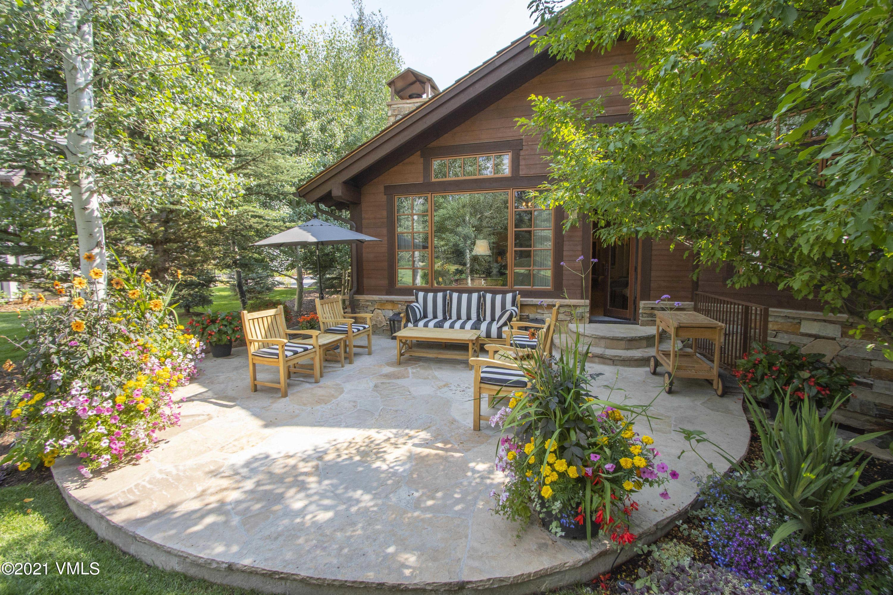 Gorgeous home with fabulous outdoor living, set on a greenbelt in Arrowhead. Beautifully remodeled with main floor living including a primary suite and office. Cozy up in the hearth room by the fireplace or head downstairs for another family room space and guest bedrooms. Lives like a single family with its own driveway.