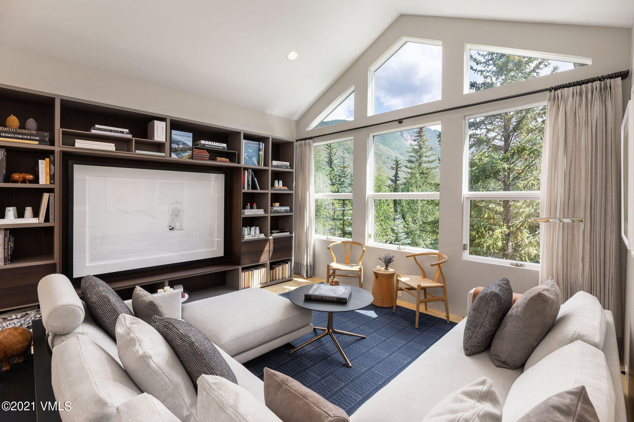 Conveniently located within walking distance of Golden Peak, this Vail Village condo lives like a private Townhome while delivering a suite of amenities including indoor/outdoor pool, spa, fitness center and property management. Remodeled with clean, soft finishes, the layout is great for large families or visiting guests. The lower level includes a heated driveway and garage, mud room, elevator access, and spacious non-conforming 5th bedroom with ensuite bath. The next level has 3 more large bedrooms and 3 baths. This home's main level is seamlessly open, anchored by a sleek, modern kitchen surrounded by a dining room and 2 separate living rooms, one with Gore Range and Vail Golf Course views, the other with a walk-out patio. This leaves a private master suite on the upper level with walk-out deck, walk-in closet and loft area for working from home. Though walking distance to Vail Village's amenities and the Ford amphitheater, this home is also located on the bus route for easy access to Lionshead or other parts of town.