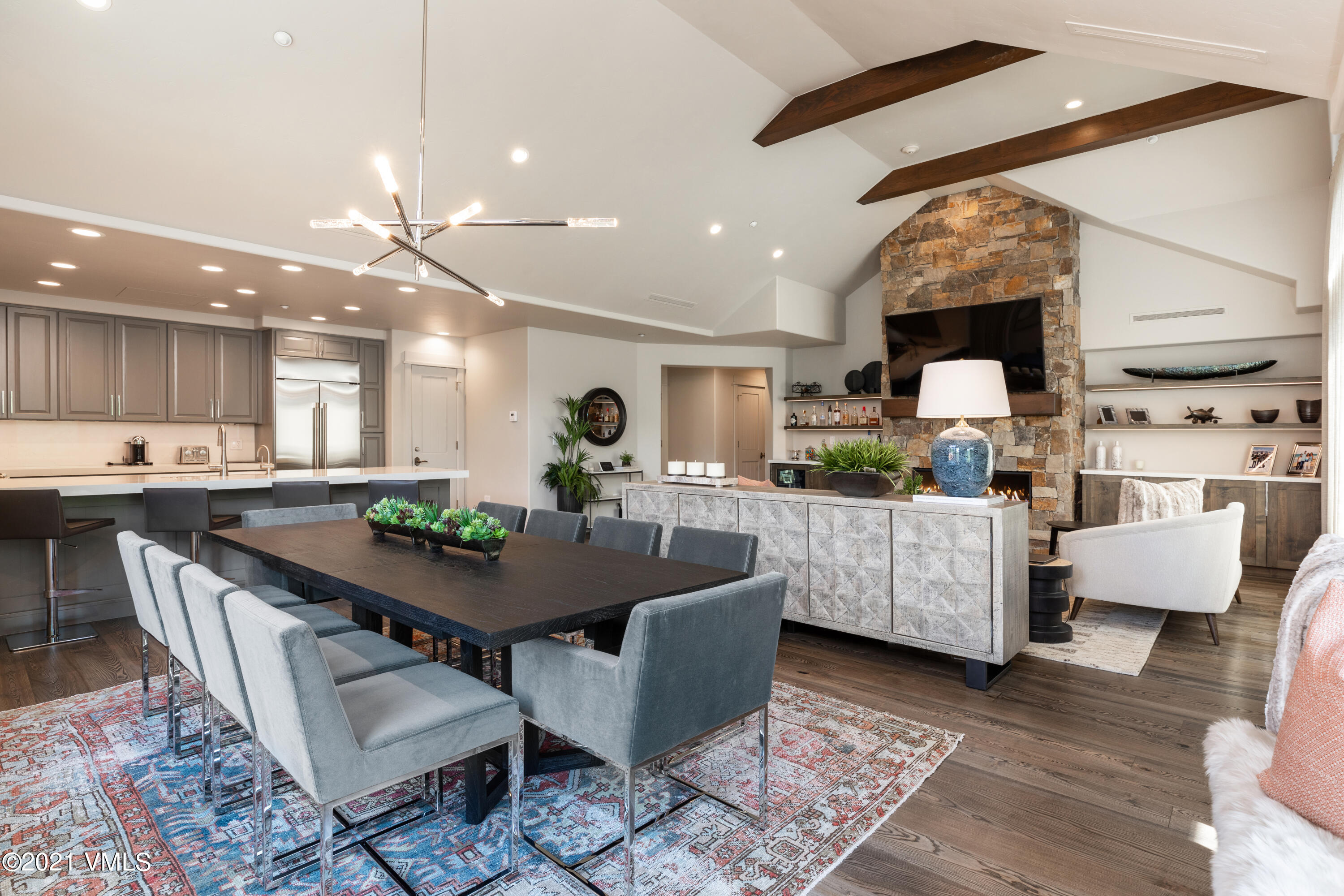 Gorgeous designer remodel just completed by Katy Allen. Enjoy living in the heart of Arrowhead, just steps to the ski lift, swimming pool, tennis courts and Country Club of the Rockies. This stunning residence lives open and easy on one floor with views of the ski slopes from the deck.