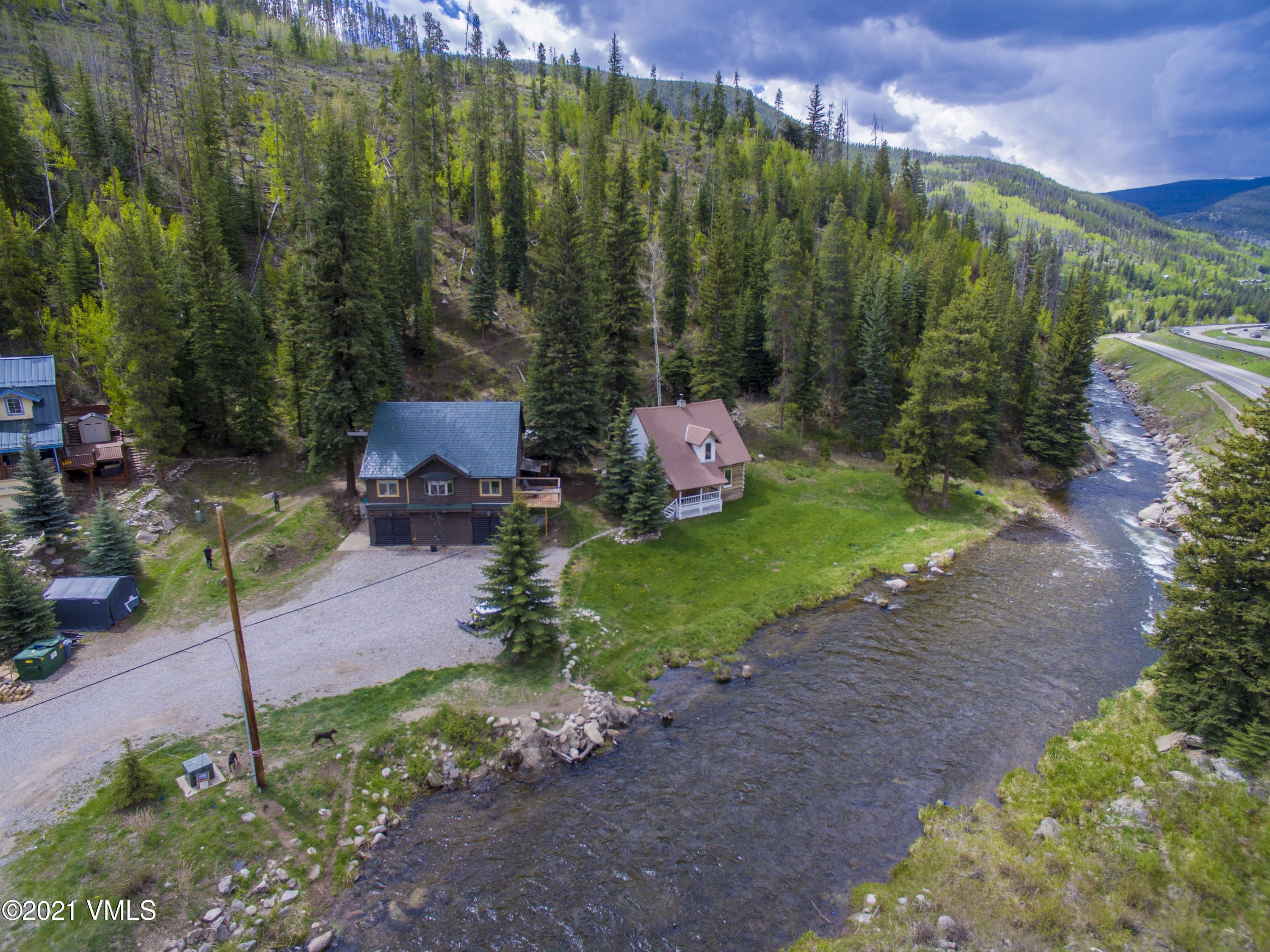 If you've ever dreamed of owning a piece of historic Vail, now is your chance. With 2.29 acres bordering National Forest and Gore Creek, 2414 Elliot Road offers two separate residences, a main house and a guest cabin. This unique property offers a mountain lifestyle without compromise. You can enjoy privacy and seclusion while also being minutes away from World-class skiing, shopping, restaurants and entertainment in Vail and Beaver Creek.  The location and land are only part of the appeal to this prime piece of Vail real estate. Both the main house and guest cabin have been tastefully renovated to feel modern, yet cozy. With 2200 square feet, four bedrooms and two bathrooms, the main house is the perfect size. The two-car garage and generous storage are mountain house must-haves for outdoor enthusiasts. The cozy four-bedroom, three-bathroom, 1700 square foot, guest cabin is a historic piece of Vail that has been preserved and renovated to uphold its timeless log cabin ambiance while offering modern updates and comfortable living, including a private hot tub. Keep it for your family and friends or use it as a reliable source of short-term rental income. Guests will love the convenient location, located on the bus route. Don't miss this rare opportunity to own a timeless historic property in Vail. This year-round retreat will be a place for family and friends to enjoy an adventurous, yet serene, mountain lifestyle for years to come. VRBO link for the historic cabin to view pictures and rental rates/calendar. https://www.vrbo.com/887739?adultsCount=2&arrival=2021-09-09&childrenCount=2&departure=2021-09-30&petIncluded=true