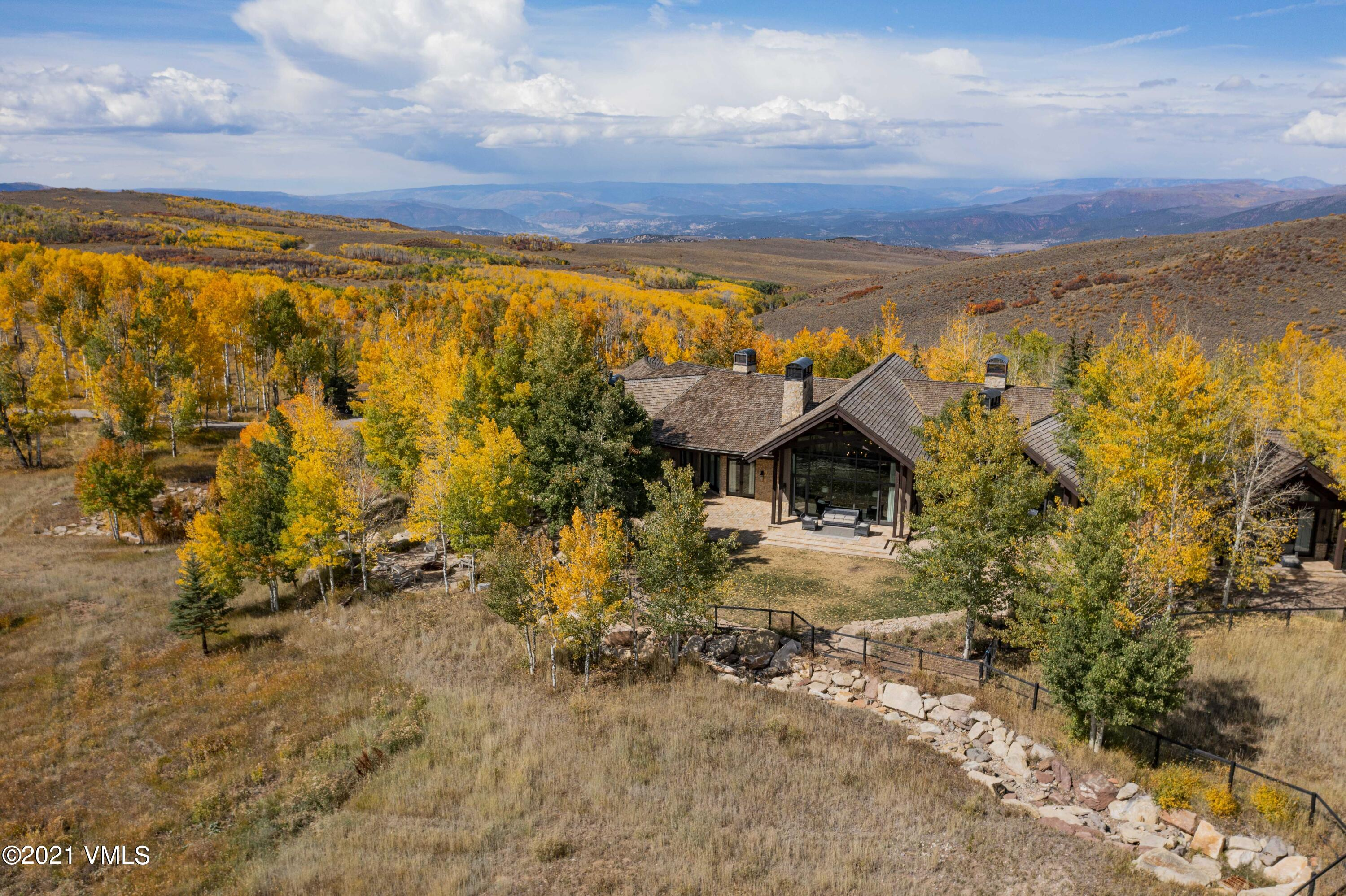 Perched atop an expansive alpine ridge, the sprawling 360-degree views from this 35+ acre property are a true rarity in the Vail Valley.  Enjoy sunrises over the full Gore Range and sitting in peaceful silence watching the alpenglow over the Back Bowls of Vail.  The gently sloping lot has a brand new split rail fence around the perimeter and pastures making this a fantastic opportunity for horse-lovers or those who prefer privacy and pristine mountain living.  Fully remodeled, the interior finishes and aesthetics of this home will impress even the most discerning taste.  An expansive main level master suite and cozy sitting area are the perfect retreat from the bright and open great room and state of the art kitchen.  The lower level boasts a gorgeous wine room and a high-end attached green house.  A unique 5+ car garage with flex space for a game room, golf simulator or toy storage makes this home a dream for the avid outdoorsman.  This property is truly unique in every way and is an absolute must-see.