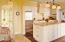 Spacious kitchen with state-of-the-art appliances, wet bar and sitting room - Photo by Ted Davis