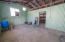 Storeroom - could be made into second living room/TV room/game room!