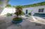 Courtyard to storage and garage