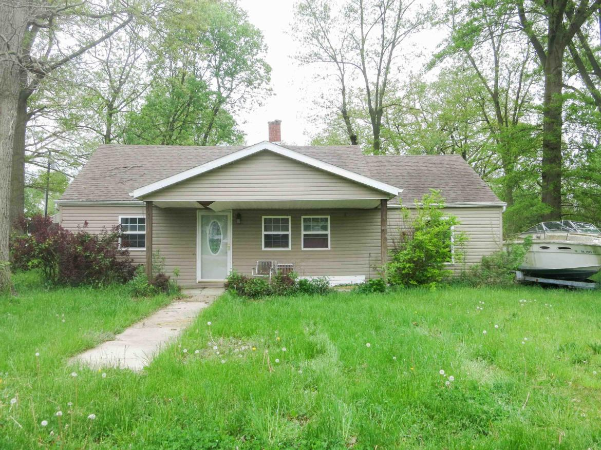 Home was purchased in 2015 with the intent to remodel.  Many walls have been torn out.   This property is basically a shell. FLOOR IS SOFT IN AREAS  BE VERY CAREFUL WHEN YOU PREVIEW.  At time of listing, property had a fairly new furnace that has never been hooked up.  Crawl space has had water in it.  Owner will take down the dead tree in front of property and is prepared to take down the house for new buyers.  Subject to satisfactory price.  House is located on lot 321 and another lot 320 is to the south.  Two blocks from the lake and St. Park  Great location.  St. Marys utilities