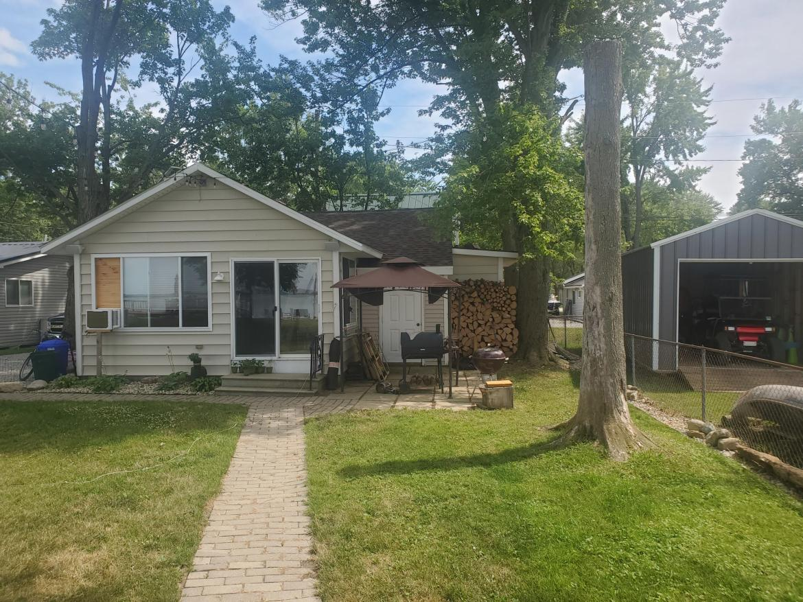 Great 1 bedroom lake house with a loft.  One of the best views on Grand Lake St Marys.  Nice sized back yard with a beautiful dock.  Buyer must be approved by owners of land before purchasing. Lot rent 350 a month includes water.