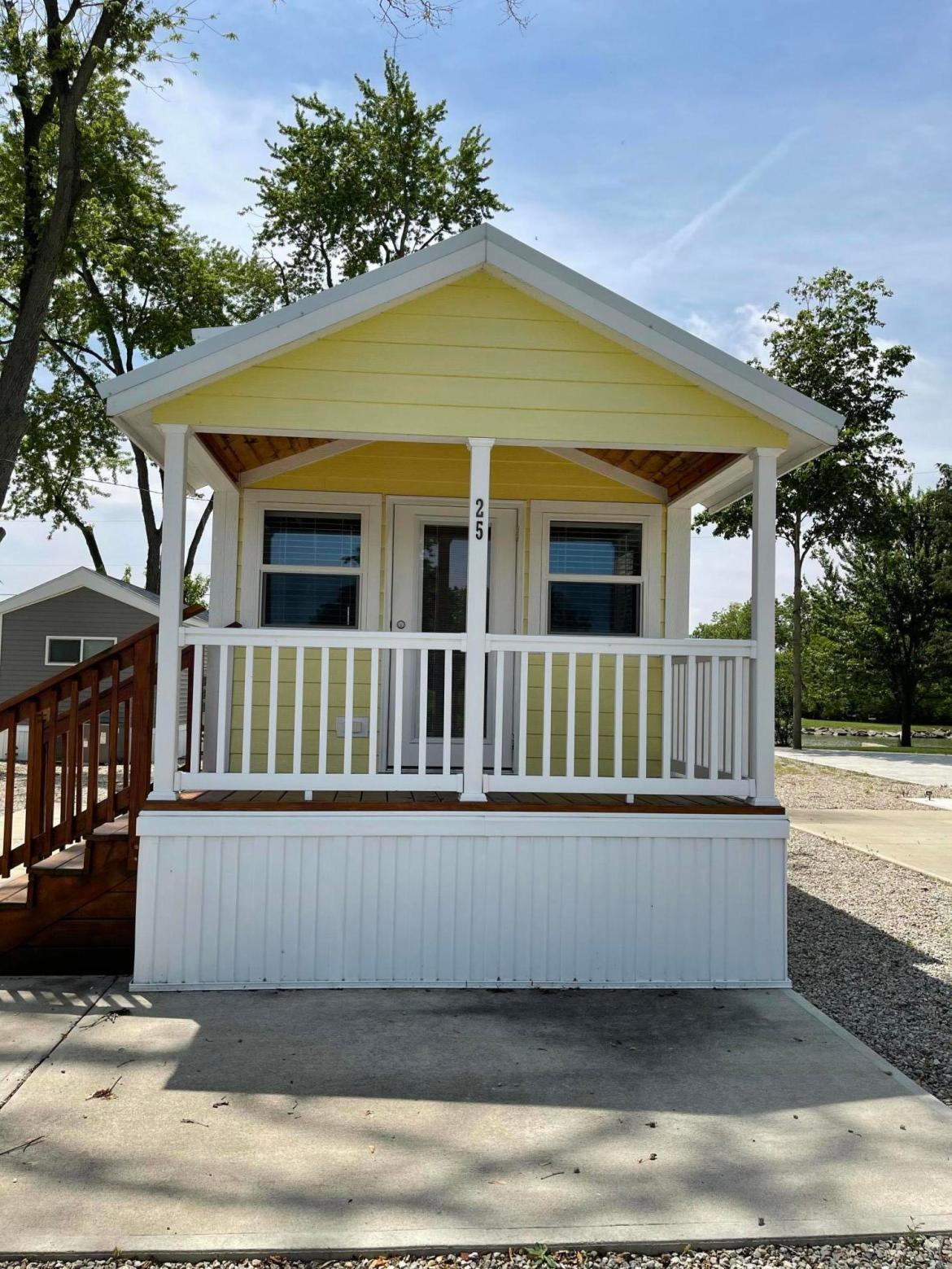 Looking for a weekend getaway, this is the place for you!!   Now is the time to start enjoying Grand Lake St. Marys, in your 2018 Canterbury Deluxe Cabin.  This one bedroom, one bath has a nice size loft for extra sleeping areas.    You can walk right out your front door, hop on your boat and take off for a day of relaxing on the lake. All appliances & furniture will stay with the cabin. Lot lease is $3,000 per year which includes, water, sewer, road maintenance, street lighting, one side of a dock & a community campfire area.  Owner pays for propane, electric, trash & cable.  There are 10x16 storage units for $600 per year on the east end of the property.  The buyer must carry $100,000 liability Insurance Coverage Policy.  There is a $40 charge for a background check on potential buyers.  Call today to check out this beautiful yellow cabin and start enjoying the summer at Park Grand Resort