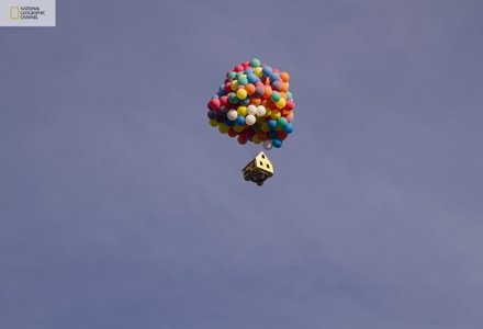 House attached to balloons flies sets world record w Video