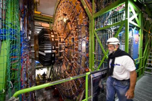 A worker walks past equipment at CERN's Large Hadron Collider, during maintenance works on July 19, 2013 in Meyrin, near Geneva