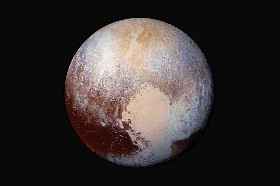 Four images from New Horizons' Long Range Reconnaissance Imager were combined with color data from the Ralph instrument to create this enhanced-color global view of Pluto. Credit: SwRI/JHUAPL/NASA   Read more at: http://phys.org/news/2015-07-horizons-hint-underground-ocean.html#jCp