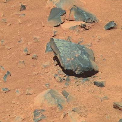 Image, taken by the Spirit rover in 2006, shows a potential rock varnish site on Mars. (NASA)