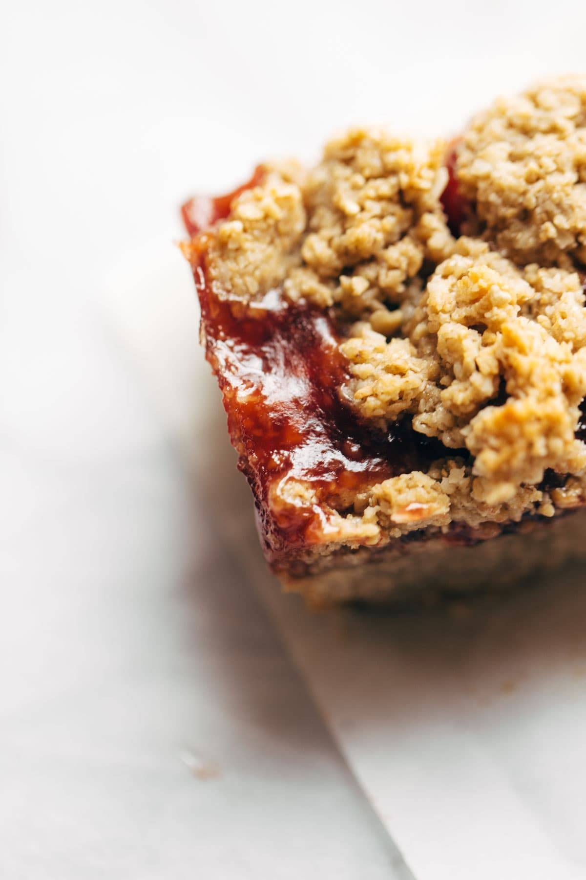 Strawberry Oat Crumble Bars - simple vegan dessert / snack bars! made with oats, sunflower seeds, coconut oil, maple syrup, and jam. | pinchofyum.com