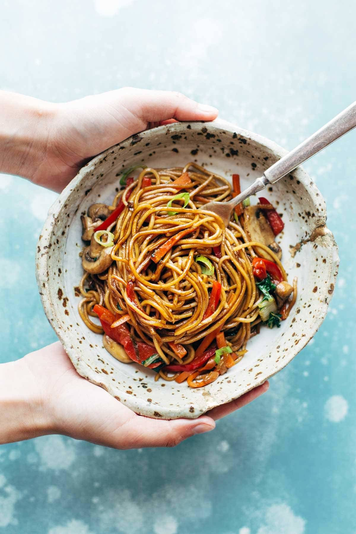 15 Minute Lo Mein! made with just soy sauce, sesame oil, a pinch of sugar, noodles, and any veggies or protein you like. SO YUMMY! vegan, vegetarian.  pinchofyum.com