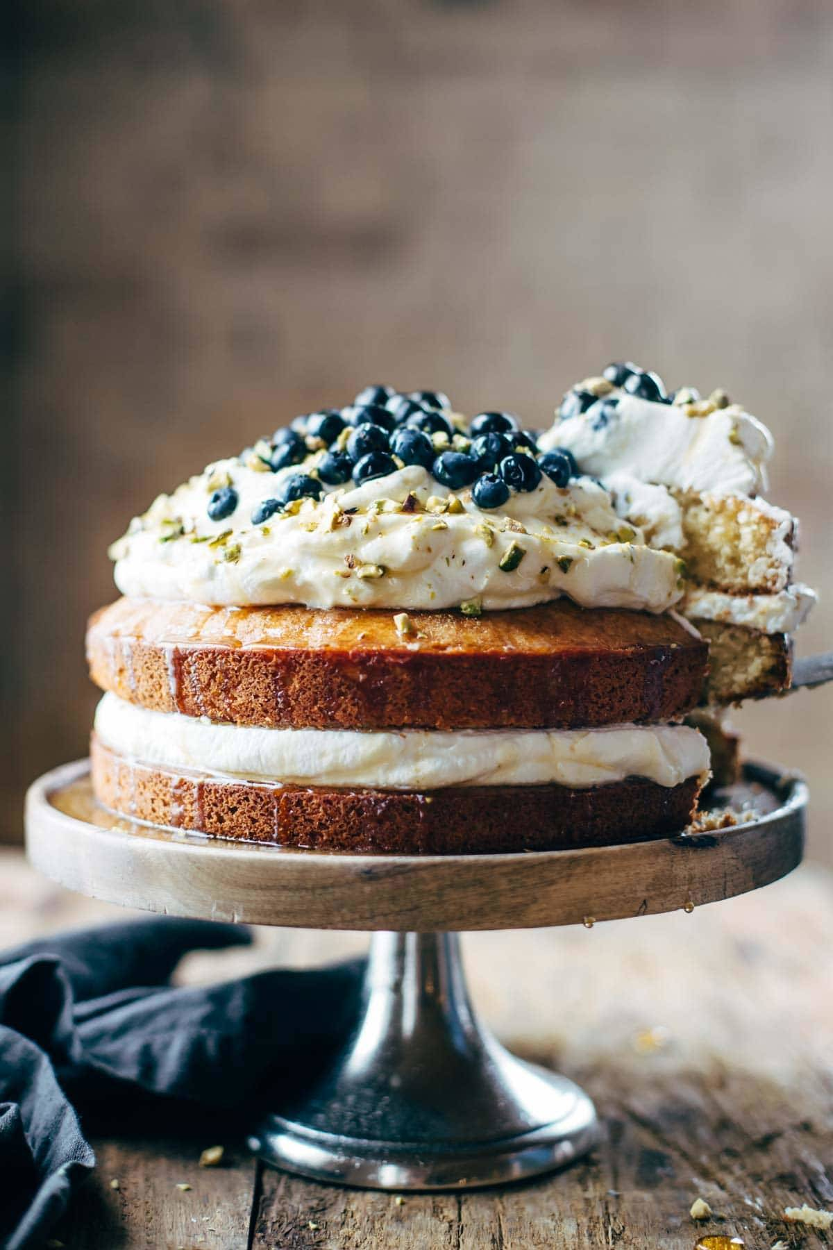 Orange Brunch Cake - SUPER YUMMY because it's made with olive oil and whole oranges! topped with whipped cream and blueberries and you're in fancy brunch business. | pinchofyum.com