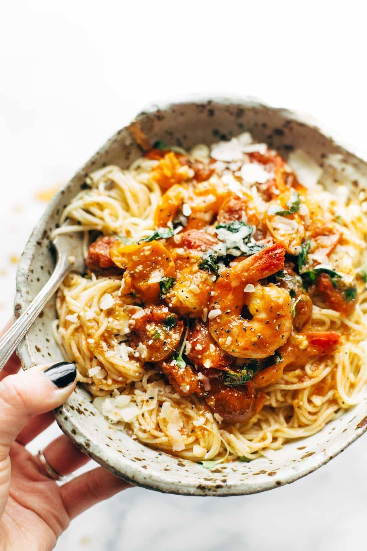 Garlic Butter Capellini Pomodoro with Shrimp - this simple recipe features easy ingredients like capellini pasta, shrimp, garlic, butter, basil, and fresh tomatoes. Ready in 30! | pinchofyum.com