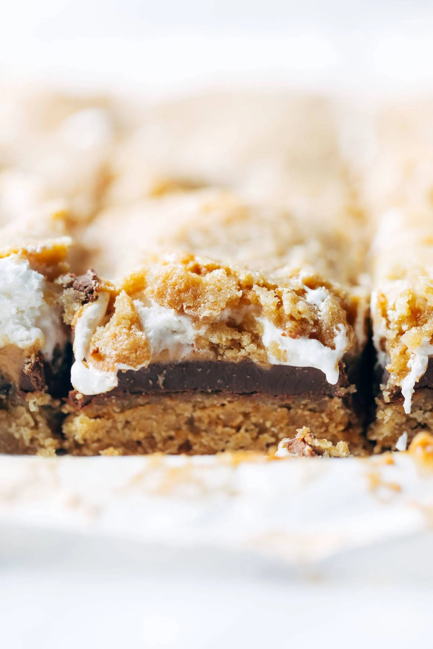 S'Mores Bars - chocolate, marshmallow, and peanut butter sandwiched between two layers of soft graham cookie crust. these are SO, SO GOOD. | pinchofyum.com