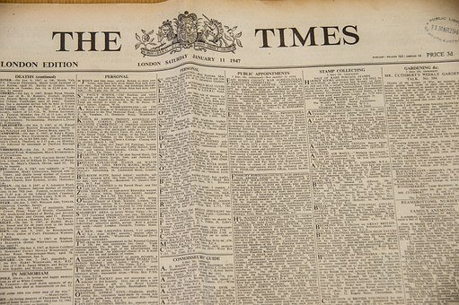 The Times newspaper showing part( of the classified ads section