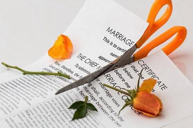 Divorce, Separation, Marriage Breakup - scissors cutting up a marriage certificate