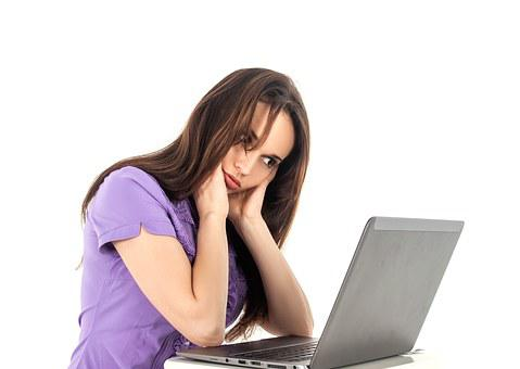 Girl sitting puzzled in front of a laptop to signify How does it work?